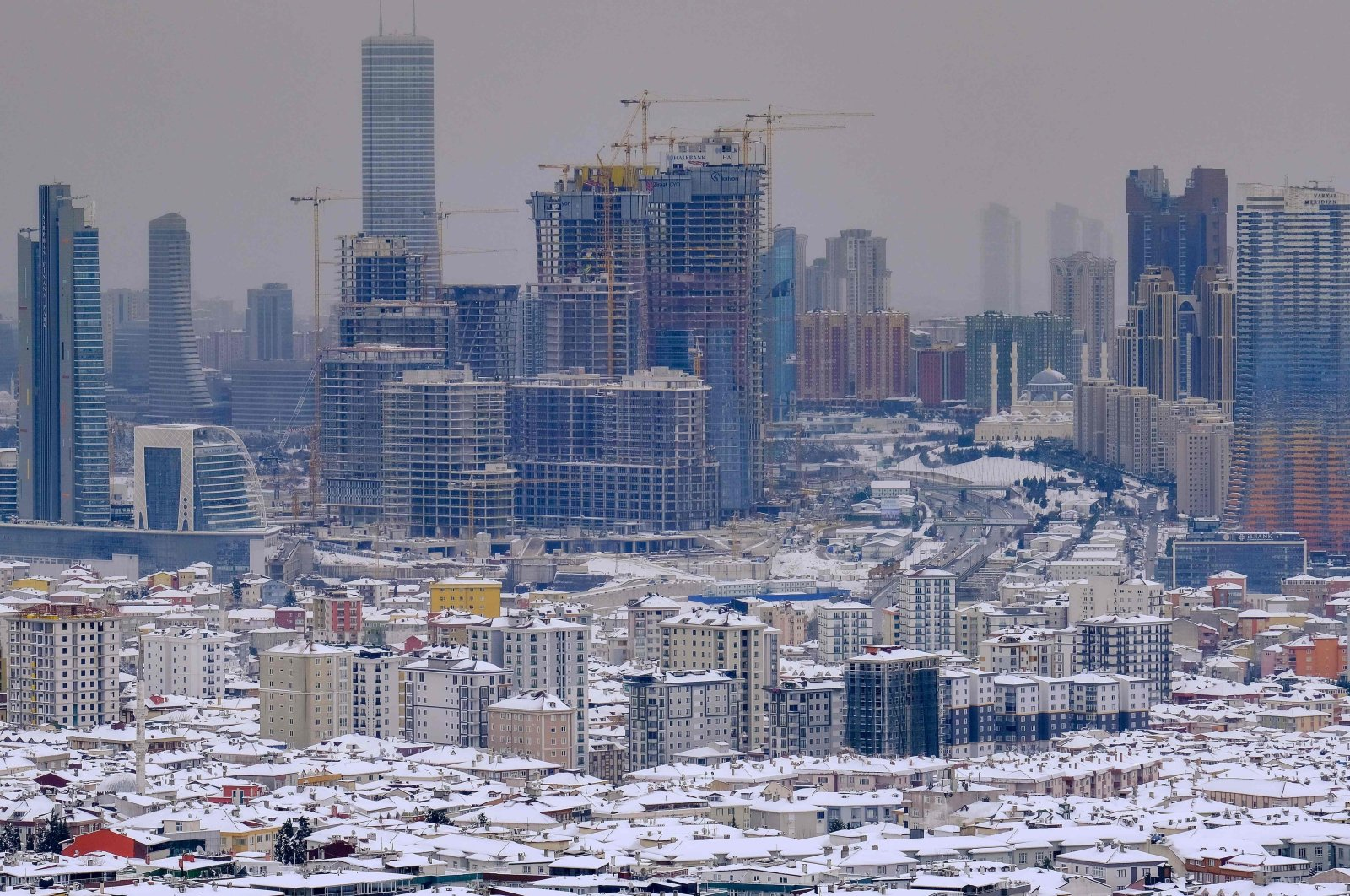 A view from Çamlıca Hill shows the Asian side of Istanbul following a snowfall, Turkey, Feb. 16, 2021. (AFP Photo)