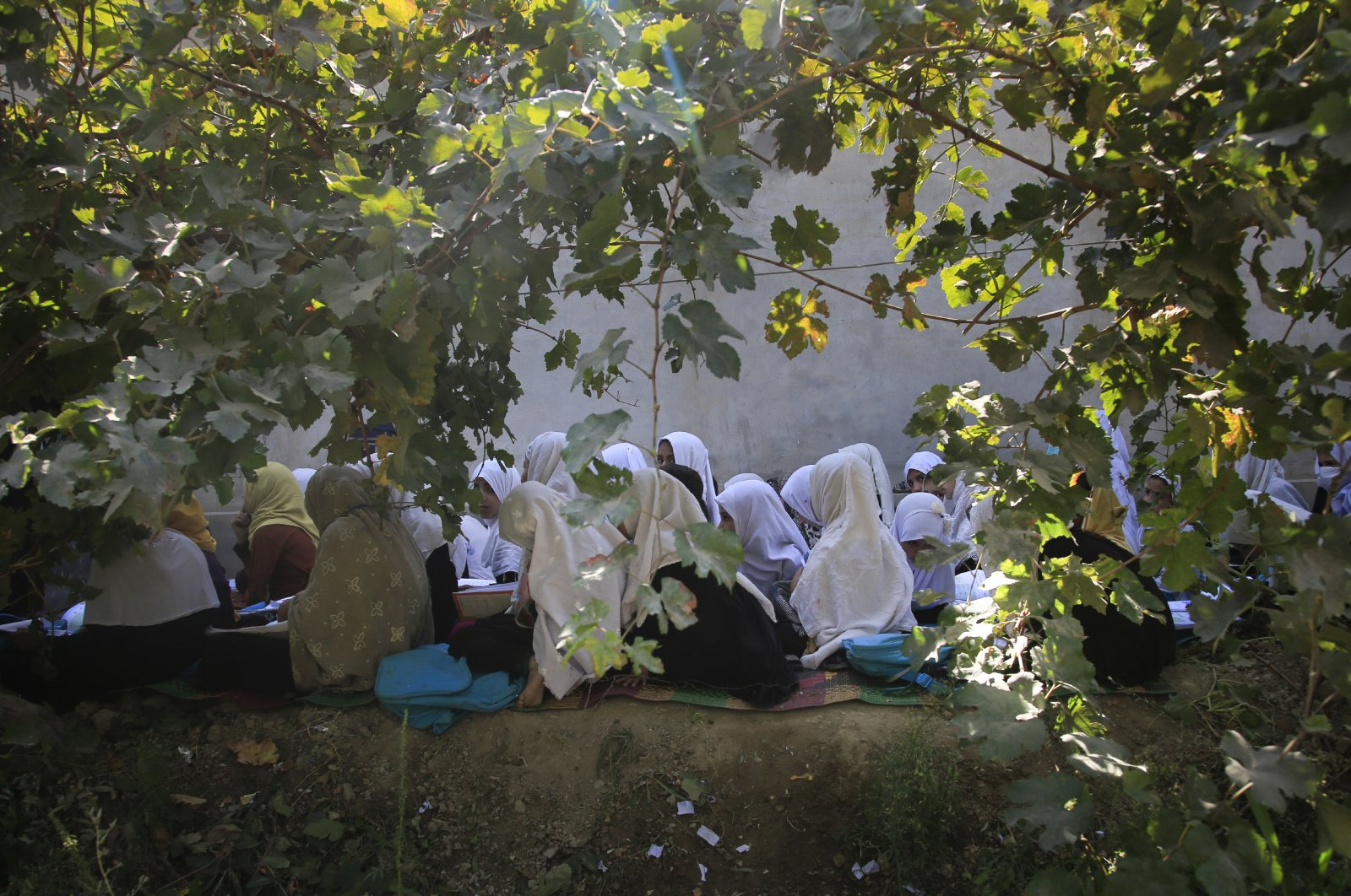 Afghan students attend an open air class at a primary school in Kabul, Afghanistan, Oct. 7, 2020. (AP Photo)