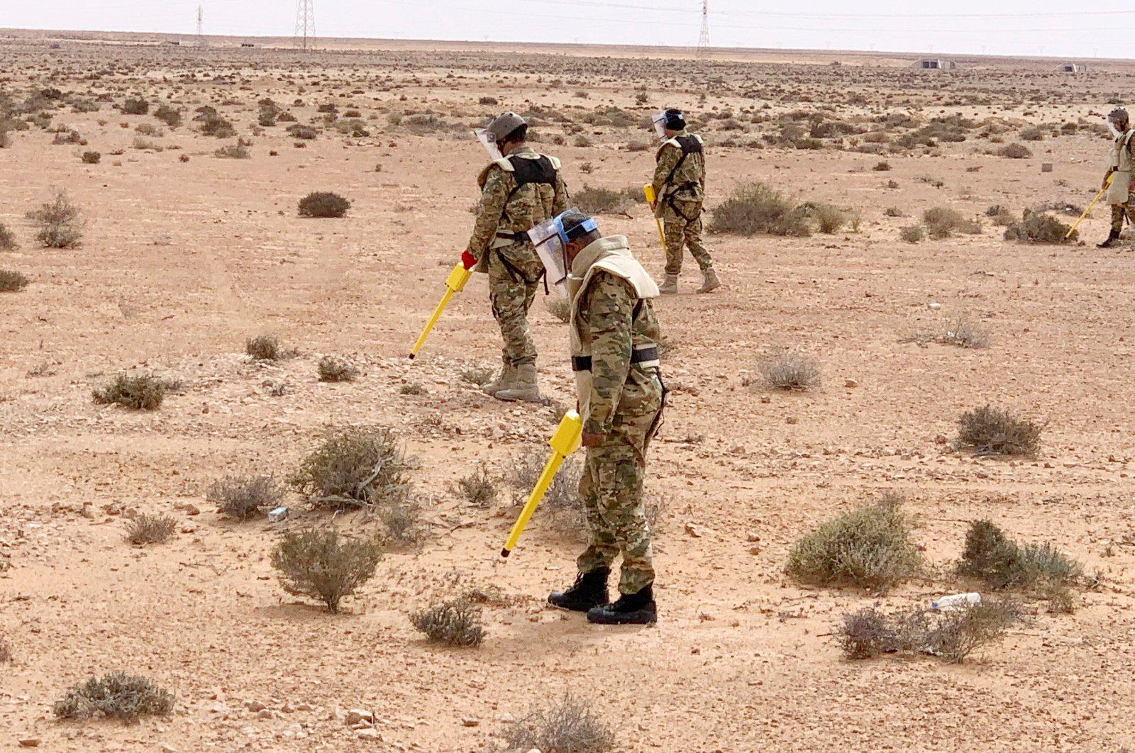 Members of the military engeneering team dismantle mines in Abu Grein, Libya, March 13, 2021. (REUTERS Photo)