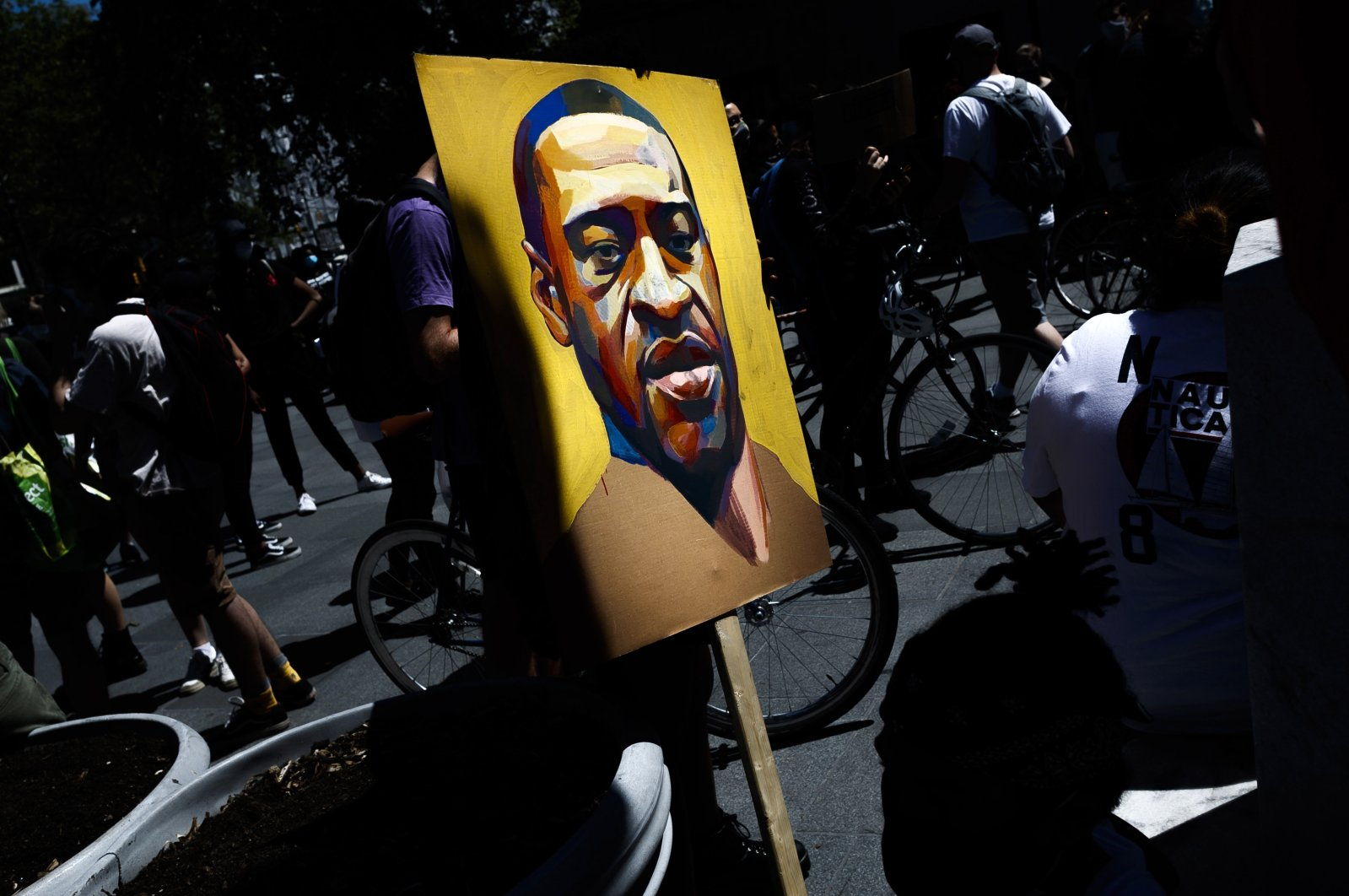 A persons holds a placard with a portrait of George Floyd at the steps of Brooklyn Borough Hall during a Black Lives Matter protest in Brooklyn, New York, U.S., June 8, 2020. (EPA Photo)