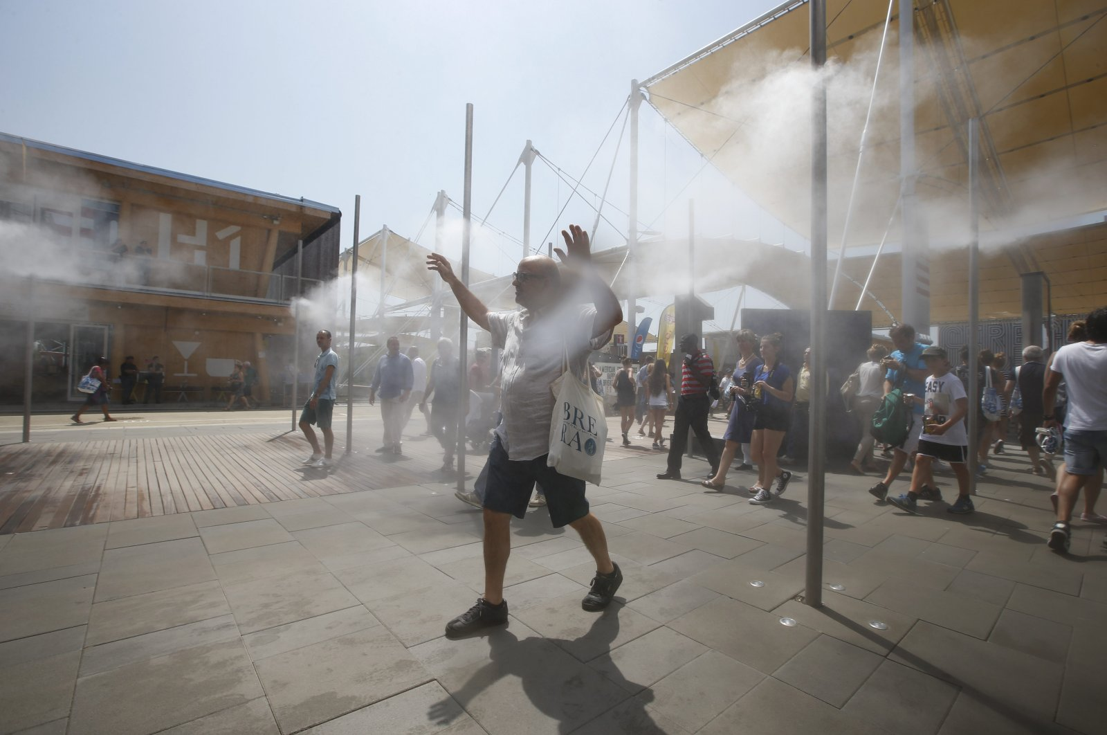 People cool off at the U.S. pavilion at the Expo 2015 world's fair in Rho, near Milan, Italy, Saturday, July 4, 2015. (AP File Photo)