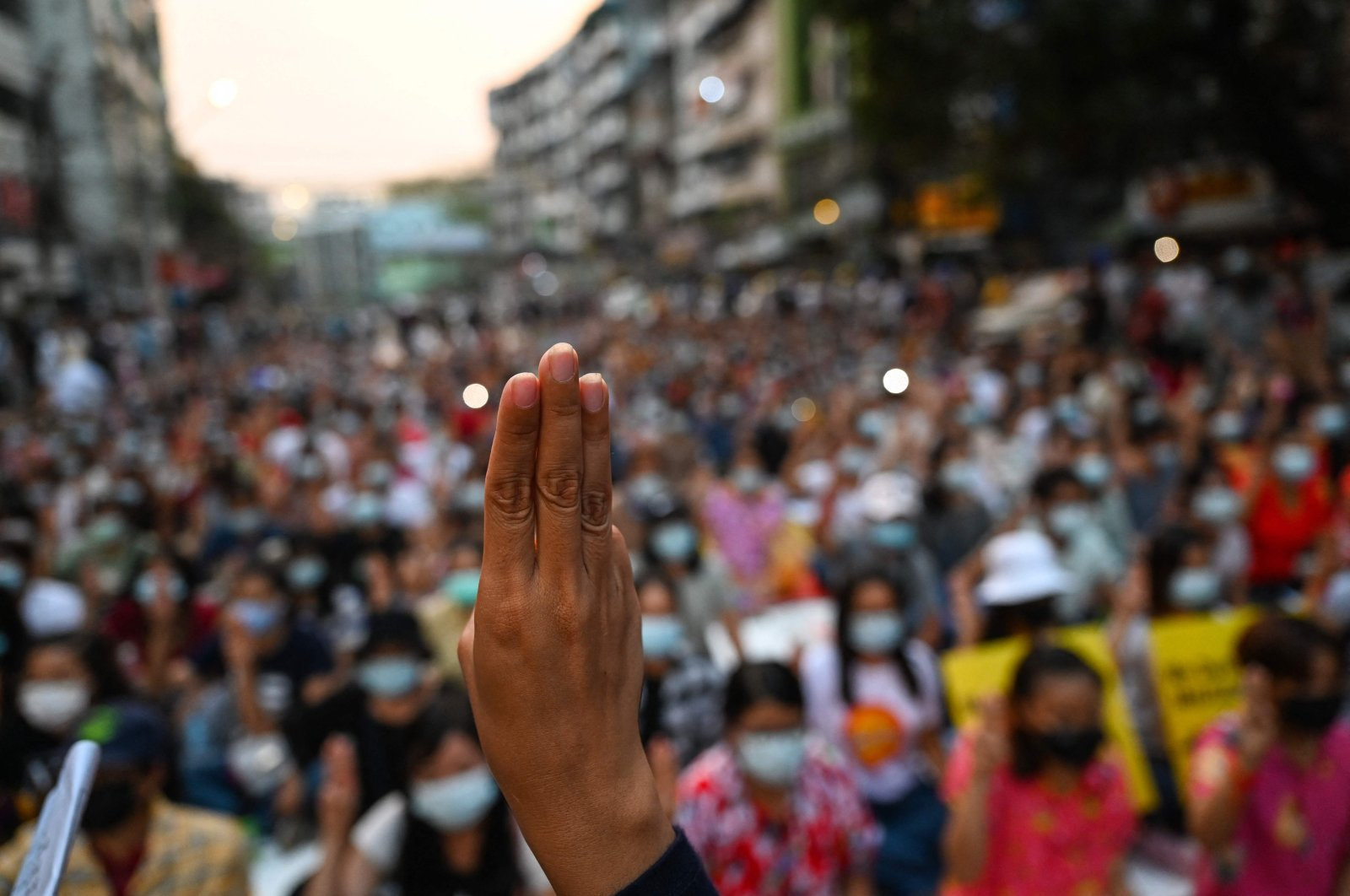 A protester makes the three-finger salute during a vigil to honor those who have died during demonstrations against the military coup in Yangon, Myanmar, March 13, 2021. (AFP Photo)
