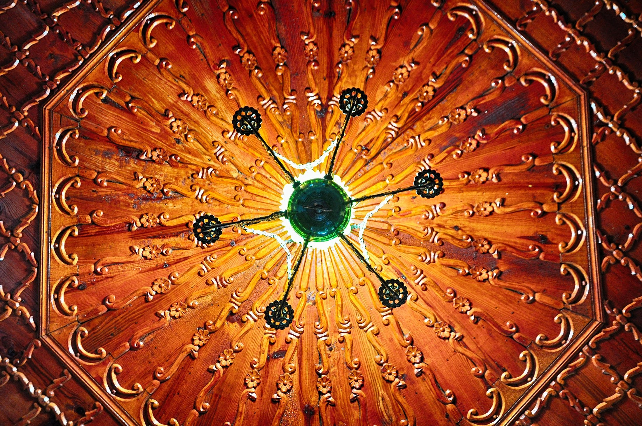 A carved, decorated wooden ceiling and chandelier at an old Ottoman house in Kula, Manisa. (Shutterstock Photo)