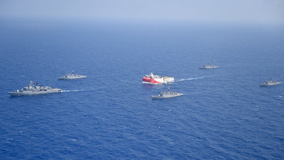 Turkey's research vessel Oruç Reis, in red and white, is surrounded by Turkish navy vessels as it sails in the west of Antalya on the Eastern Mediterranean, Turkey, Aug. 10, 2020. (AP)