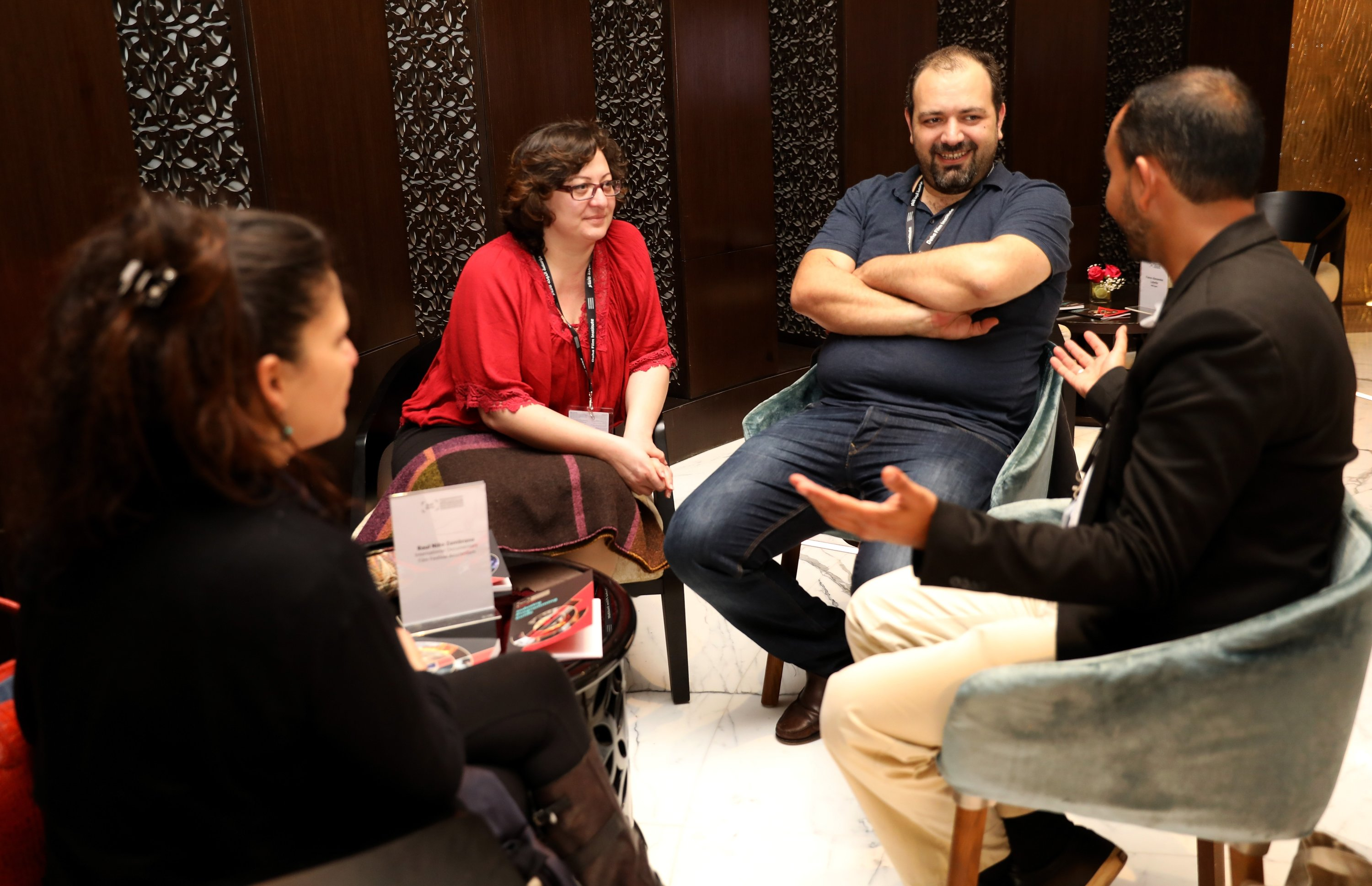 Director Diana El Jeiroudi (second left) and producer Orwa Nyrabia (second right) meet with Raul Nino Zambrano (R) from International Documentary Film Festival Amsterdam during a one-on-one session on day three of the 3rd Qumra Festival on March 5, 2017, in Doha, Qatar. (Getty Images)