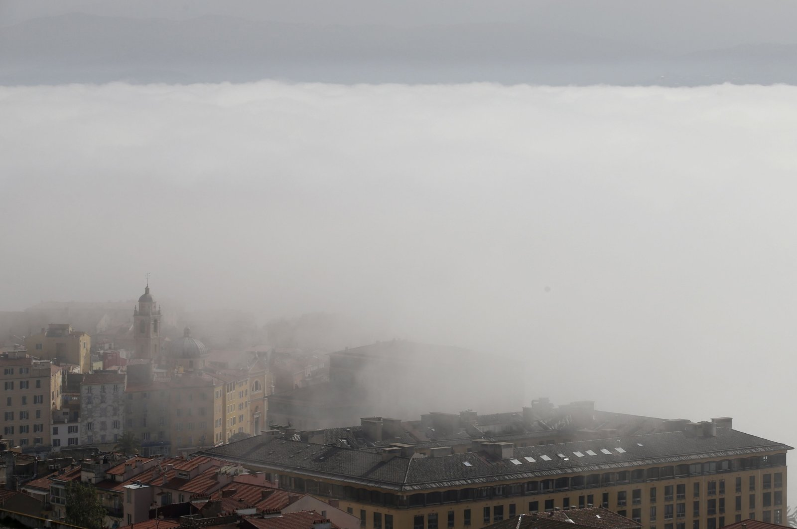 Smog and pollution settle over the capital Ajaccio on the French Mediterranean island of Corsica on Feb. 25, 2021. (AFP Photo)