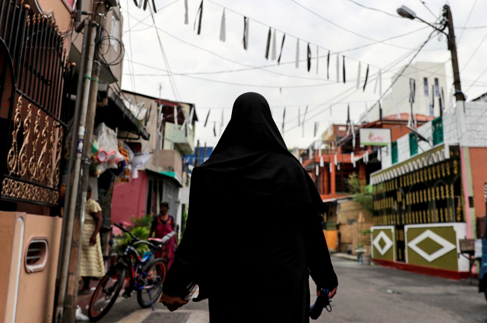 A Muslim woman wearing a hijab walks through a street near St Anthony's Shrine, days after a string of suicide bomb attacks across the island on Easter Sunday, in Colombo, Sri Lanka, April 29, 2019. (Reuters Photo)
