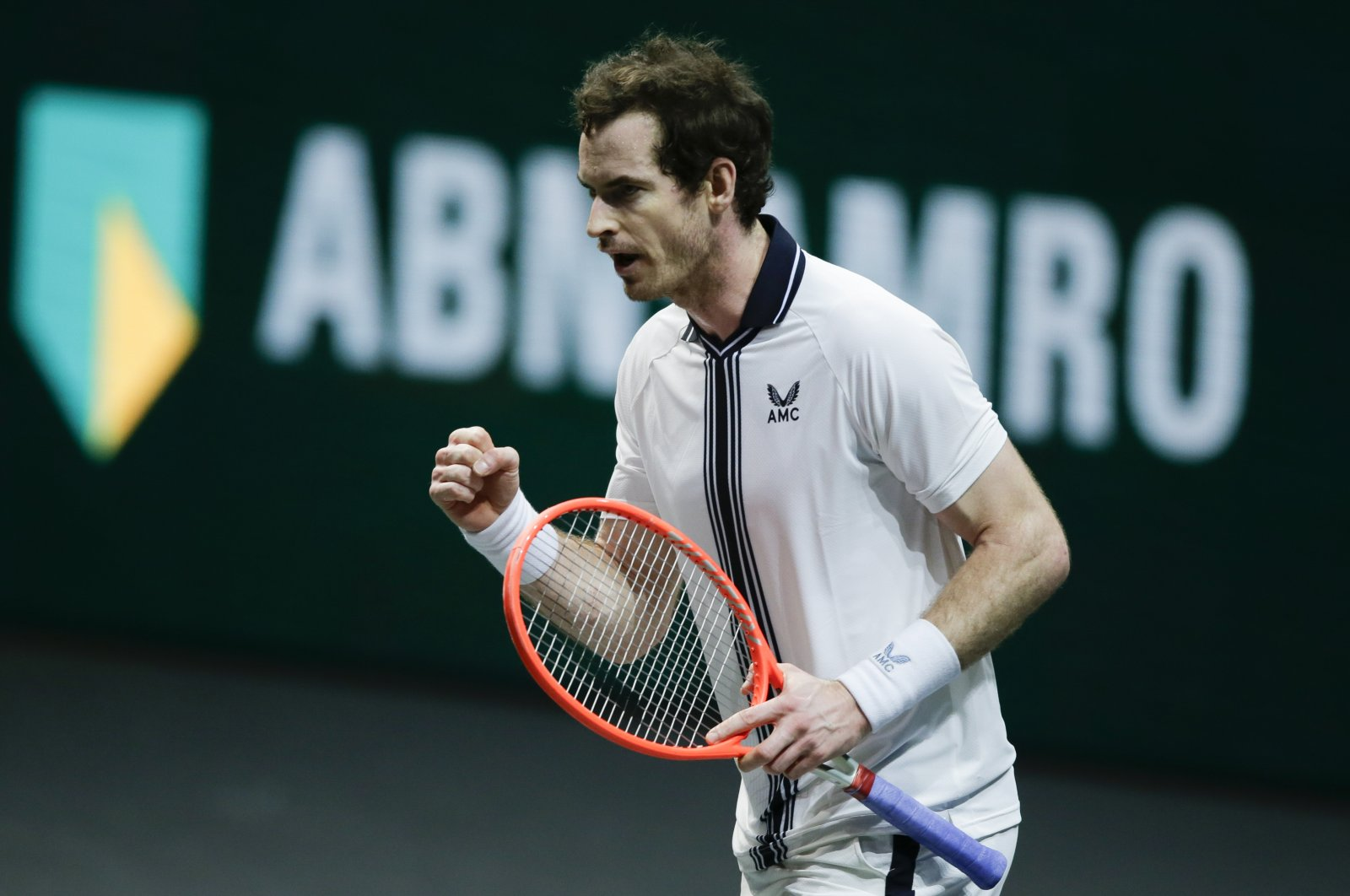 Britain's Andy Murray clenches his fist after defeating Netherland's Robin Haase in the ABN AMRO world tennis tournament at Ahoy Arena in Rotterdam, Netherlands, March 1, 2021. (AP Photo)