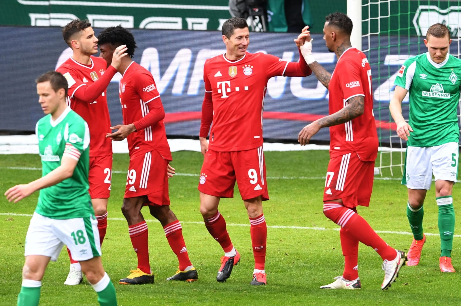 Bayern Munich's Polish forward Robert Lewandowski (C) celebrates with teammates during a Bundesliga match against Werder Bremen, Bremen, northern Germany, March 13, 2021. (AFP Photo)