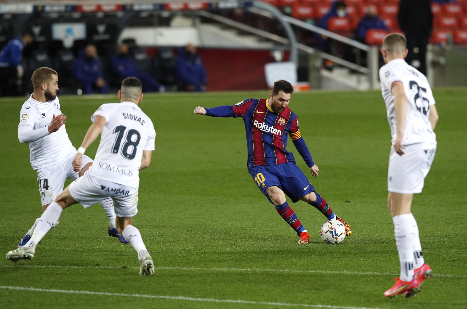 Barcelona forward Lionel Messi scores against Huesca in a La Liga match at Camp Nou, Barcelona, Spain, March 15, 2021. (Reuters Photo)