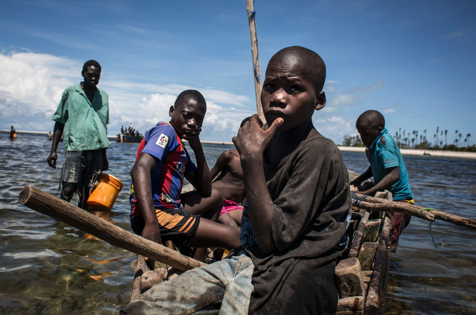 Young Mozambican fishermen return to the shore after several days of fishing near where large deposits of natural gas were found, in Palma, Mozambique, Feb. 16, 2017. (AFP Photo)