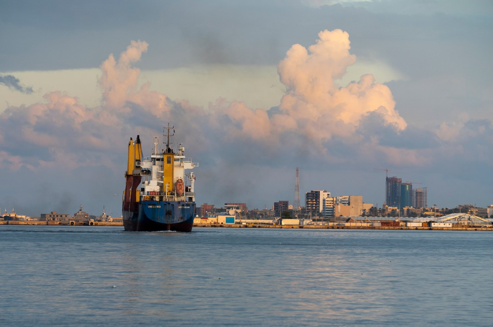 A container ship leaves the port of Tripoli after unloading its cargo, Tripoli, Libya, Nov. 25, 2020. (Shutterstock Photo)
