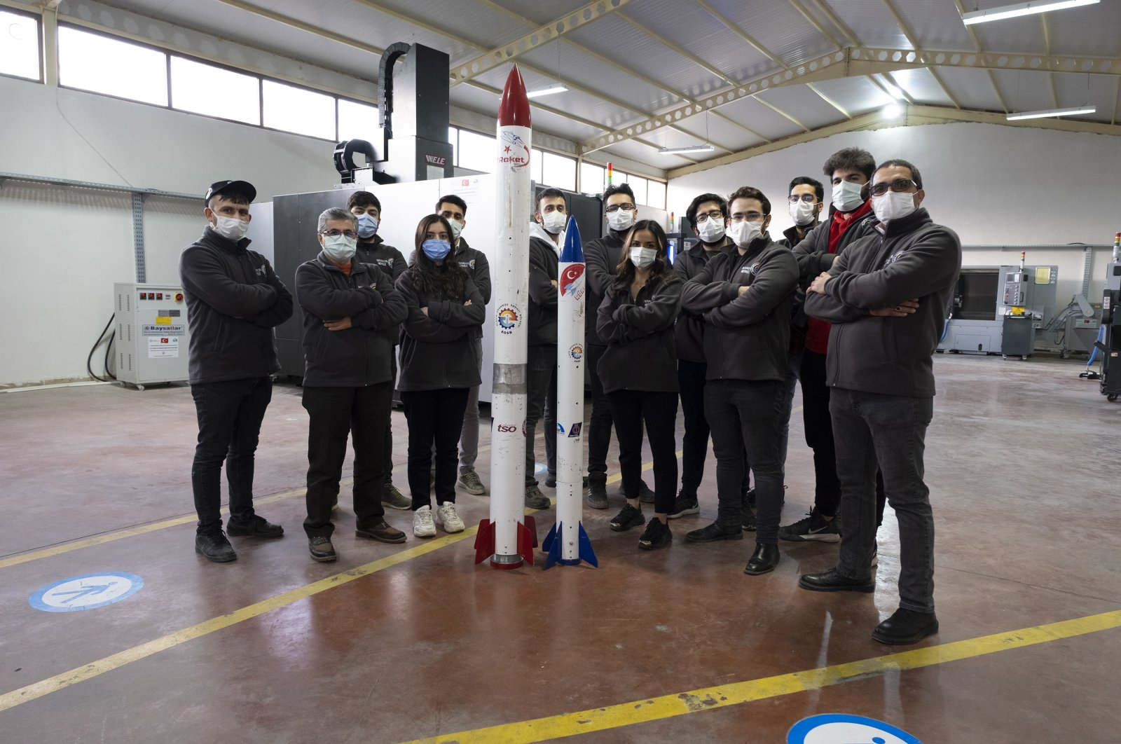 A Teknofest team with their designed and developed 'Gökruh' rocket seen in the Industry and Technology Minister's innovation center for youth in Elazığ, eastern Turkey, Feb. 26, 2021. (DHA Photo)