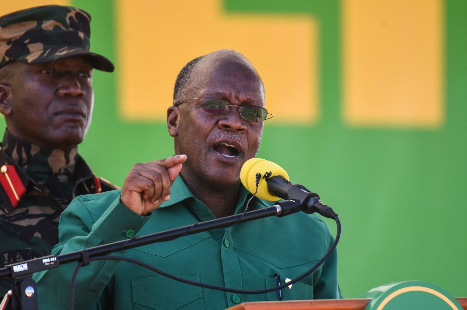 Tanzania's President and presidential candidate of ruling party Chama Cha Mapinduzi (CCM) John Magufuli (R) speaks during the official launch of the party's campaign for the October general election at the Jamhuri stadium in Dodoma, Tanzania, Aug. 29, 2020. (AFP Photo)