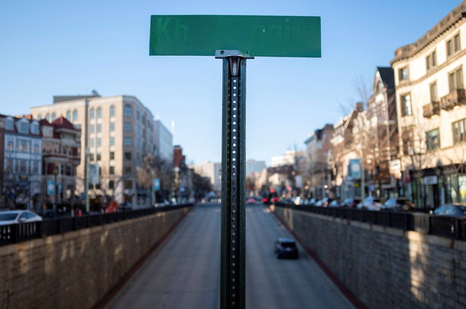 """A symbolic street sign named """"Khashoggi Way"""" stands above Connecticut Avenue in the Dupont Circle neighborhood of Washington, U.S., March 2, 2021. (Reuters Photo)"""