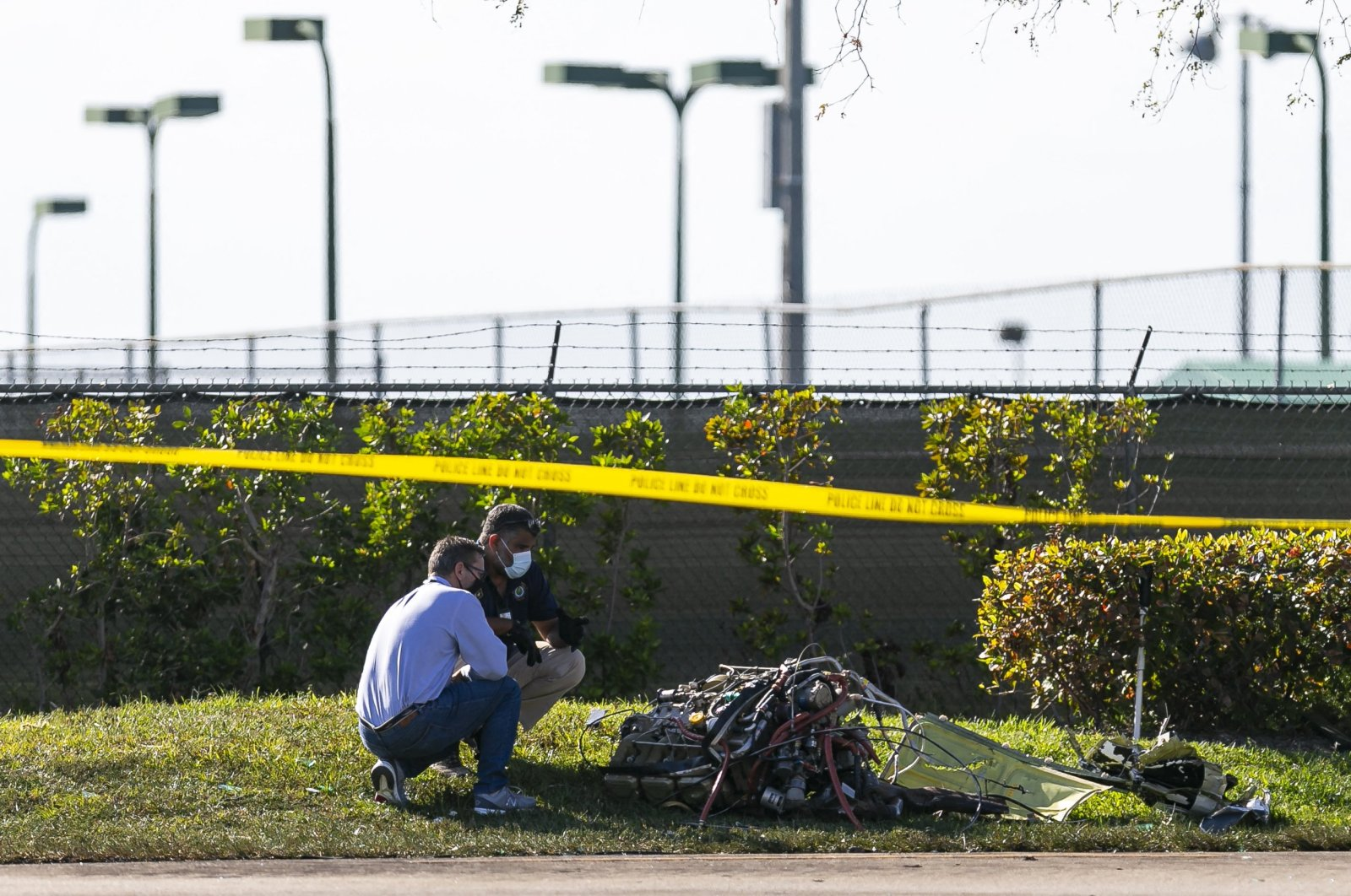 First responders look through debris from an accident scene after a small plane crashed near the 1300 block of Southwest 72nd Avenue in Pembroke Pines, Florida on Monday, March 15, 2021. (Reuters Photo)