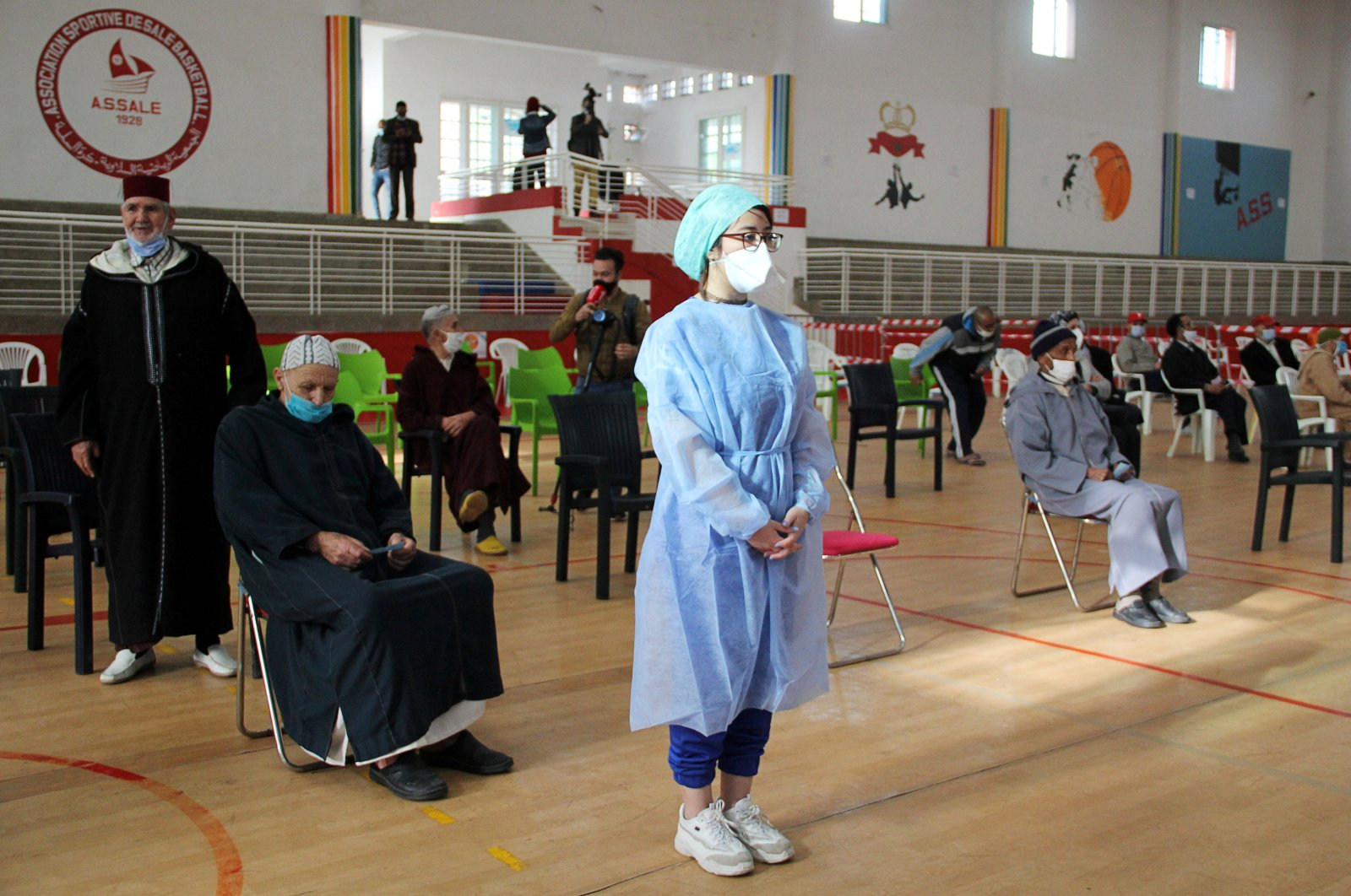 People wait to receive the COVID-19 vaccine, during a national coronavirus vaccination campaign, in Sale, Morocco, Jan. 29, 2021. (REUTERS)