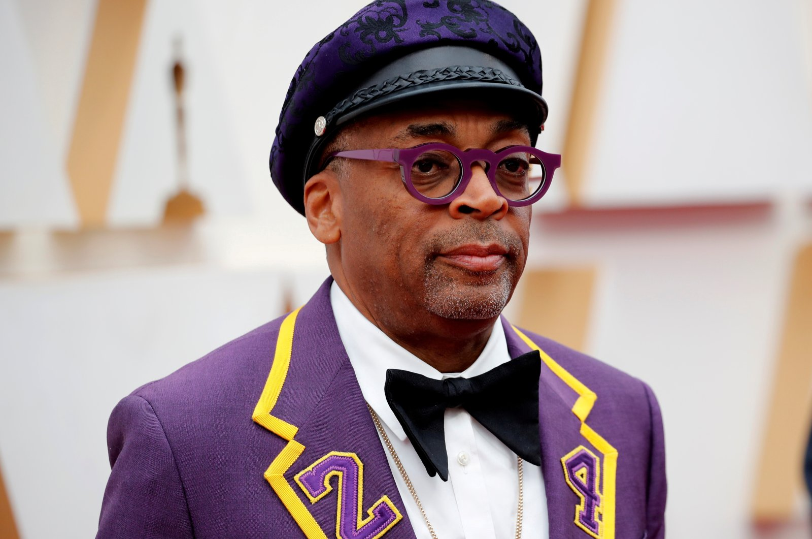 Director Spike Lee, wearing a coat with the number 24 in memory of NBA player Kobe Bryant, poses on the red carpet during the Oscars arrivals at the 92nd Academy Awards in Hollywood, Los Angeles, California, U.S., Feb. 9, 2020. (Reuters Photo)