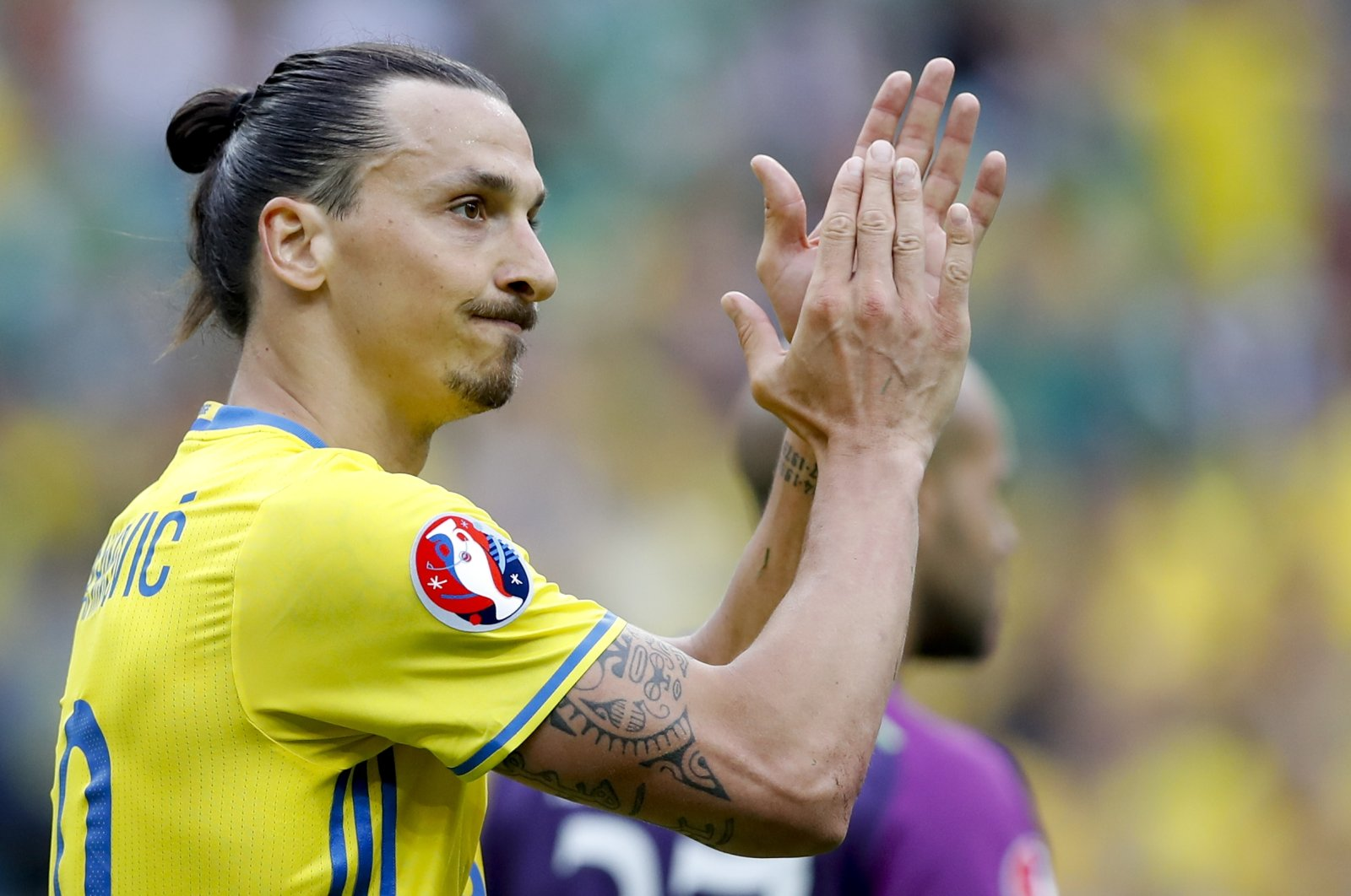 Sweden's Zlatan Ibrahimovic applauds during the Euro 2016 Group E football match between Ireland and Sweden at the Stade de France in Saint-Denis, north of Paris, France, June 13, 2016. (AP Photo)