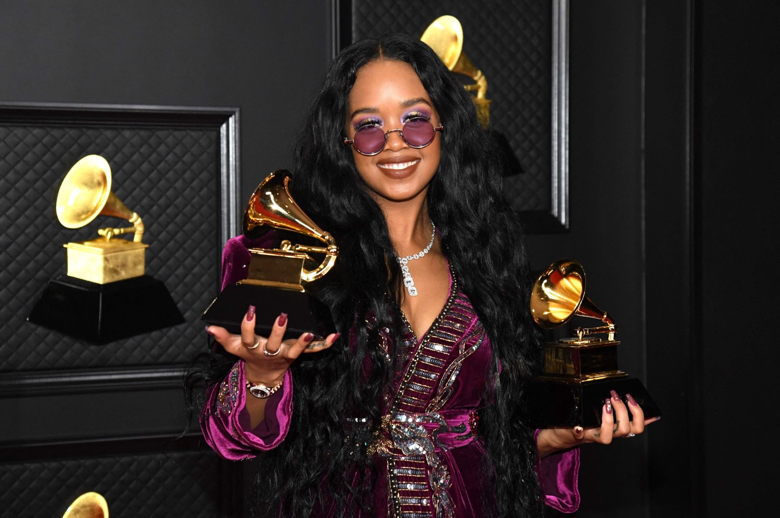 H.E.R., winner of the Best R&B Song and the Song of the Year awards poses in the media room during the 63rd Annual Grammy Awards in Los Angeles, California, U.S., March 14, 2021. (AFP)