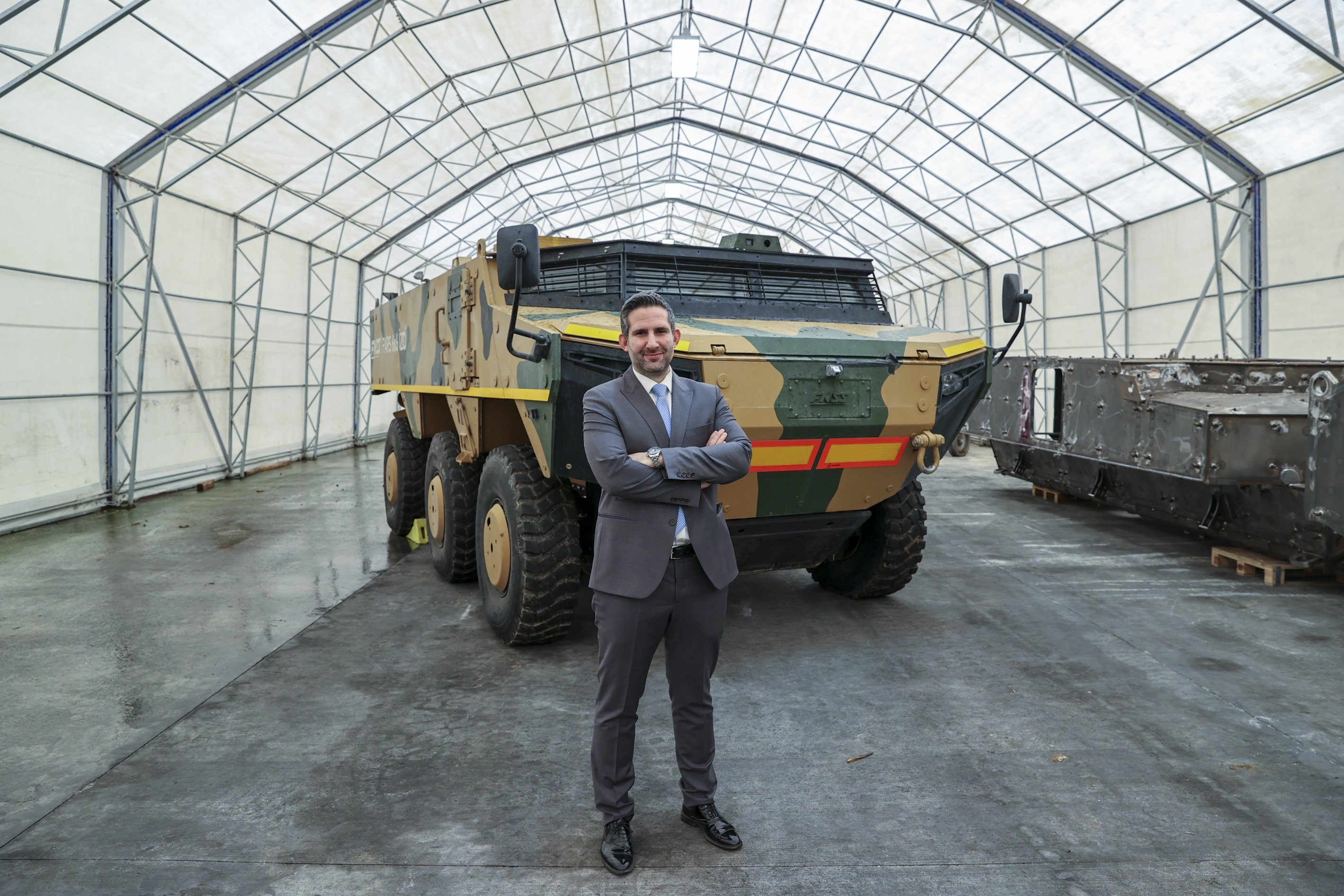 Can Kurt, project coordinator at the FNSS seen in front of the company's Pars Scout vehicle, March 17, 2021. (AA Photo)