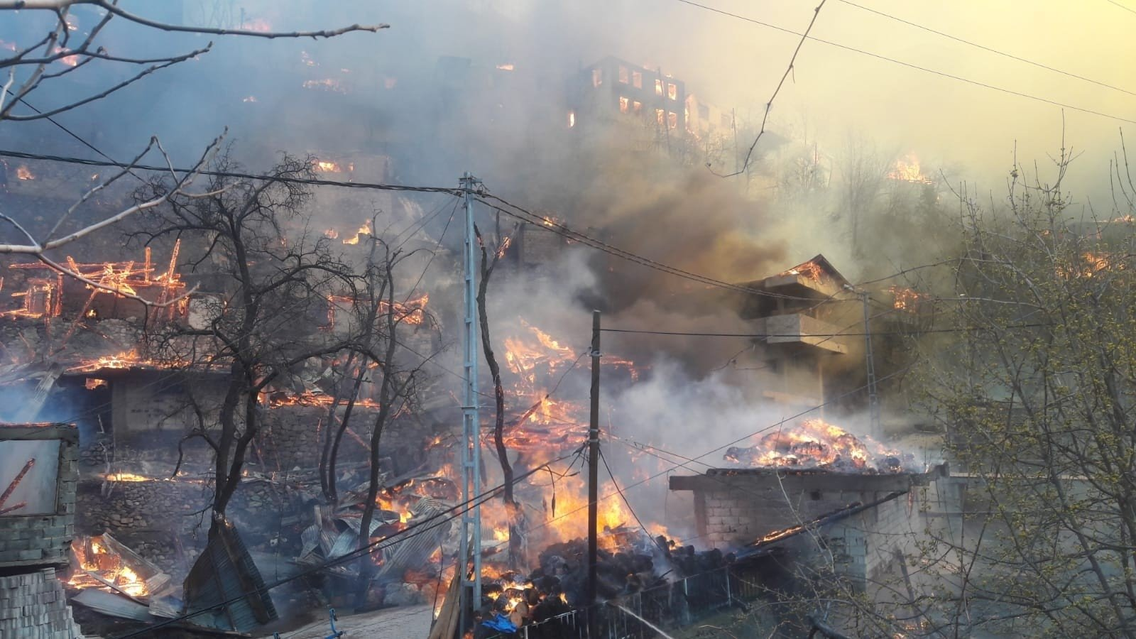 A view of flames engulfing the houses in the village, in Artvin, northeastern Turkey, March 17, 2021. (İHA PHOTO)