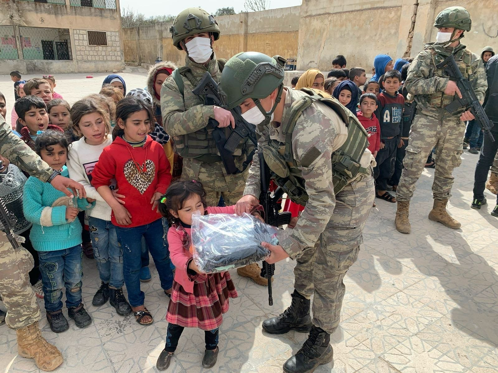 Turkish soldiers deliver clothes and toys collected during an aid campaign in Turkey's northern province of Zonguldak to the displaced Syrian refugee children, Idlib, northern Syria, March 11, 2021. (AA Photo)
