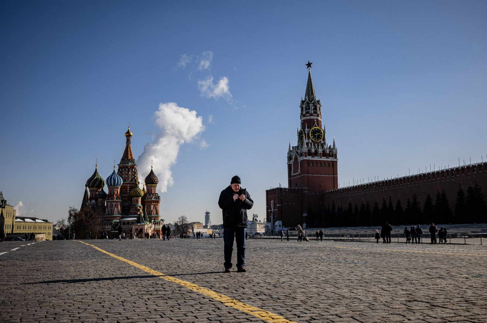 A man uses his mobile phone on Red Square in downtown Moscow, Russia, March 10, 2021. (AFP Photo)