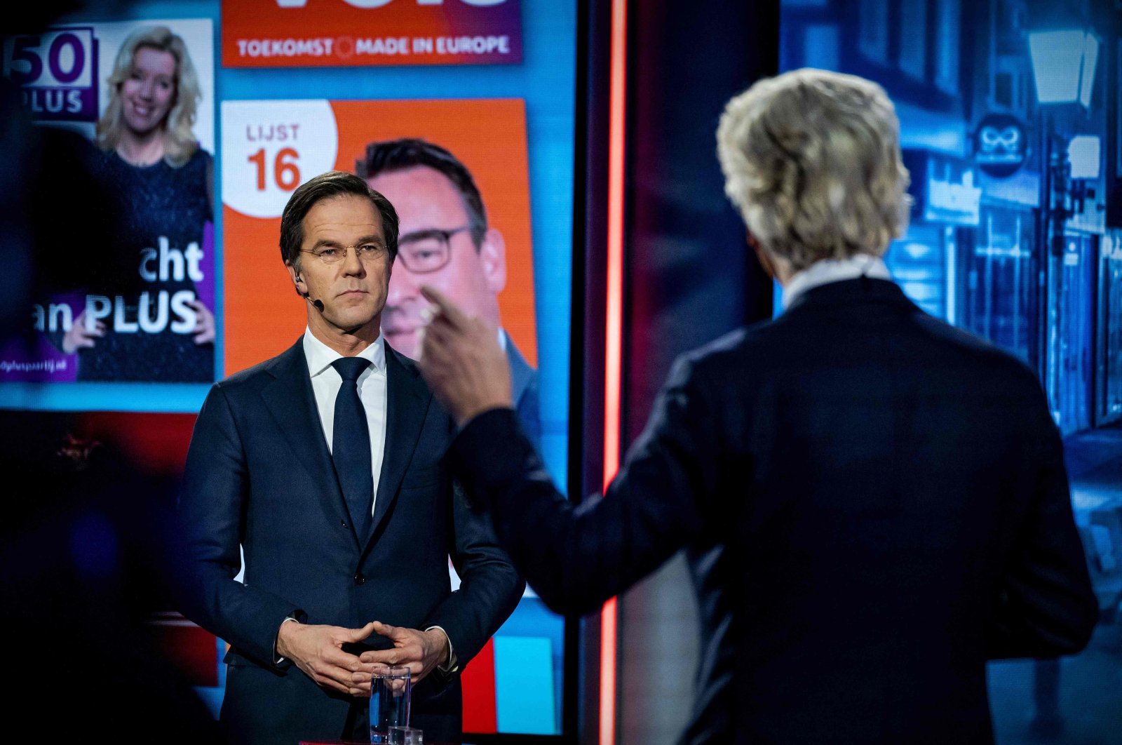 Dutch Prime Minister Mark Rutte (L) of VVD and PVV leader Geert Wilders take part in an election debate over the public broadcast corporation NOS, Netherlands, March 16, 2021. (AFP)