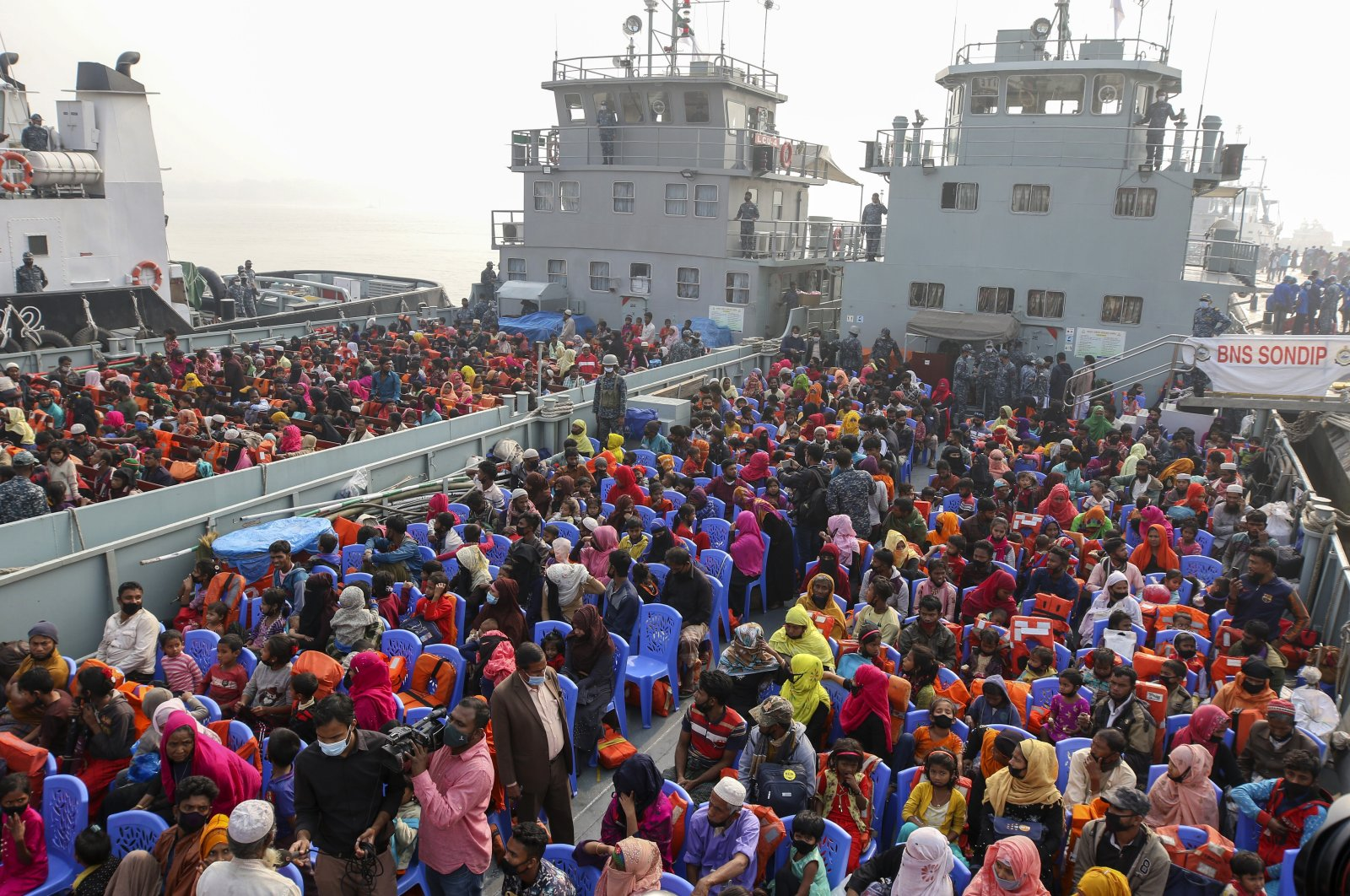 Rohingya refugees headed to the Bhasan Char island board navy vessels from the south eastern port city of Chattogram, Bangladesh, Feb. 15, 2021. (AP Photo)