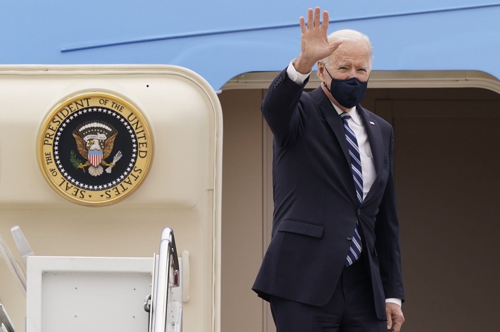 U.S. President Joe Biden waves from the top of the steps of Air Force One as he prepares to depart for a trip to Pennsylvania, at Andrews Air Force Base, Maryland, U.S., March 16, 2021. (AP Photo)