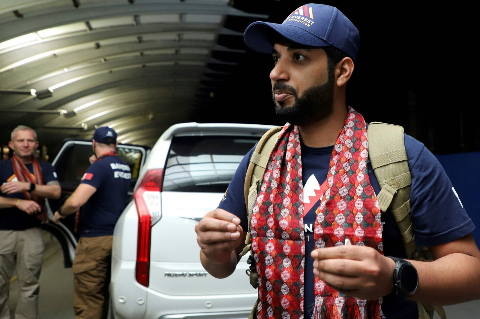 Sheikh Mohamed Hamad Mohamed Al Khalifa (R) arrives at Tribhuvan International Airport to climb Mount Everest, Kathmandu, March 15, 2021. (AFP Photo)