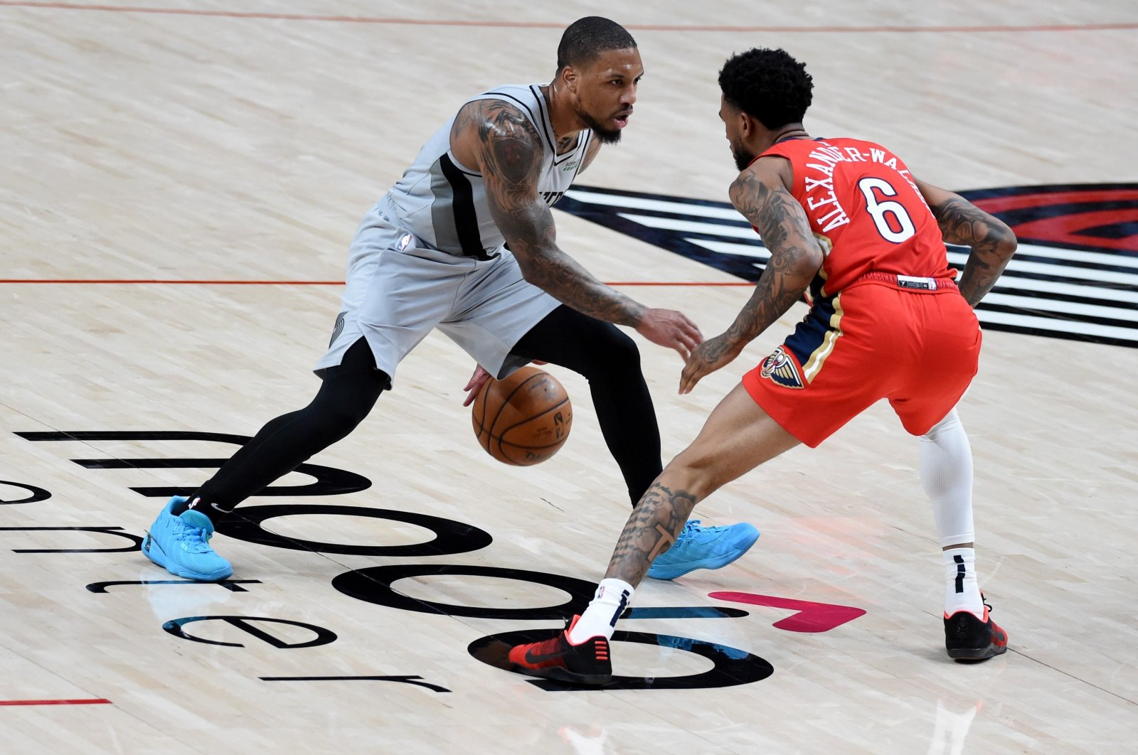Portland Trail Blazers Damian Lillard (L) tries to go past New Orleans Pelicans' Nickeil Alexander-Walker during an NBA game at Moda Center, Portland, Oregon, March 16, 2021. (AFP Photo)