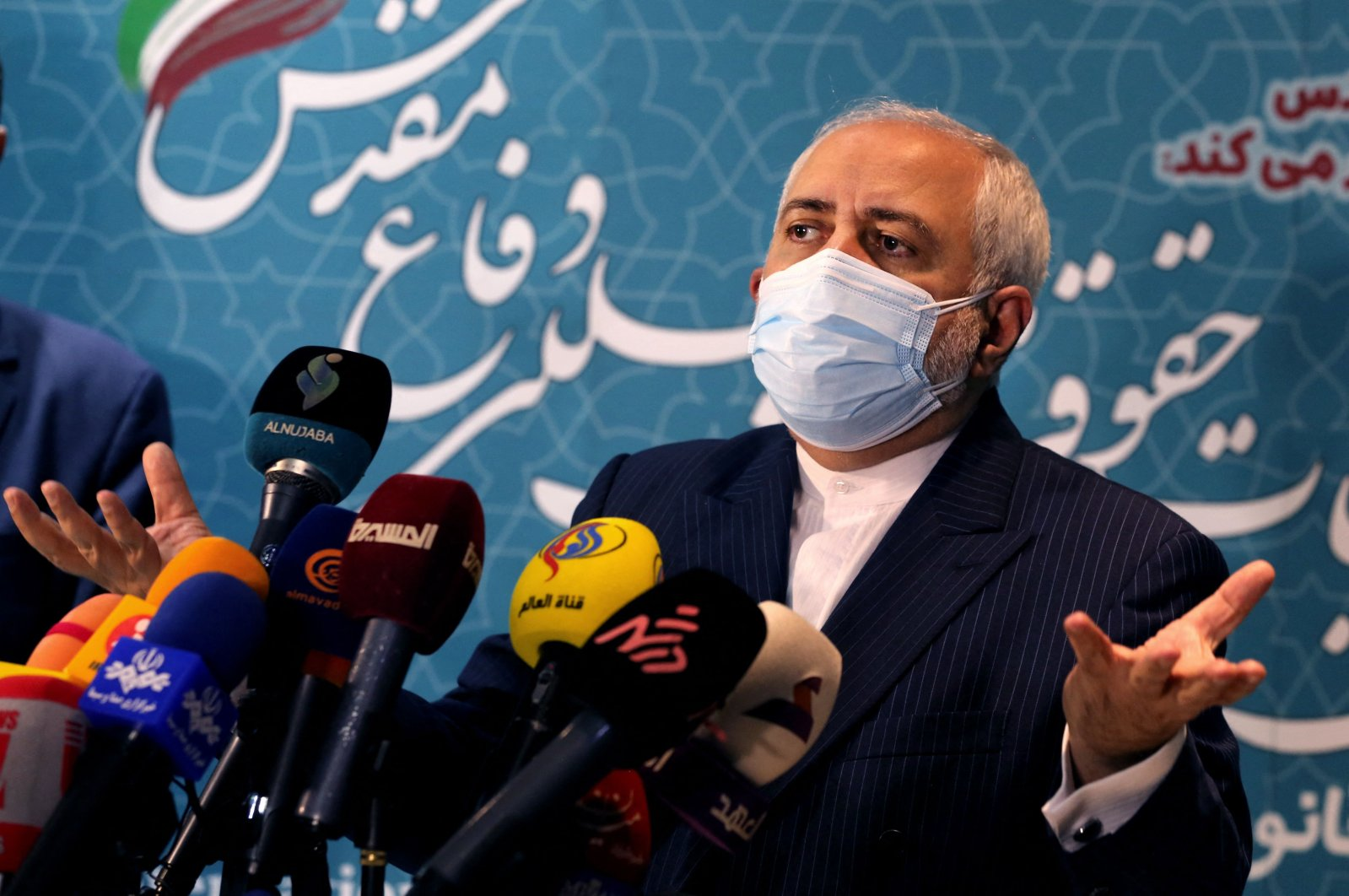 Iranian Foreign Minister Mohammad Javad Zarif speaks during a press conference at the International Conference on the Legal-International Claims of the Holy Defense, in Tehran, Iran, Feb. 23, 2021. (AFP Photo)