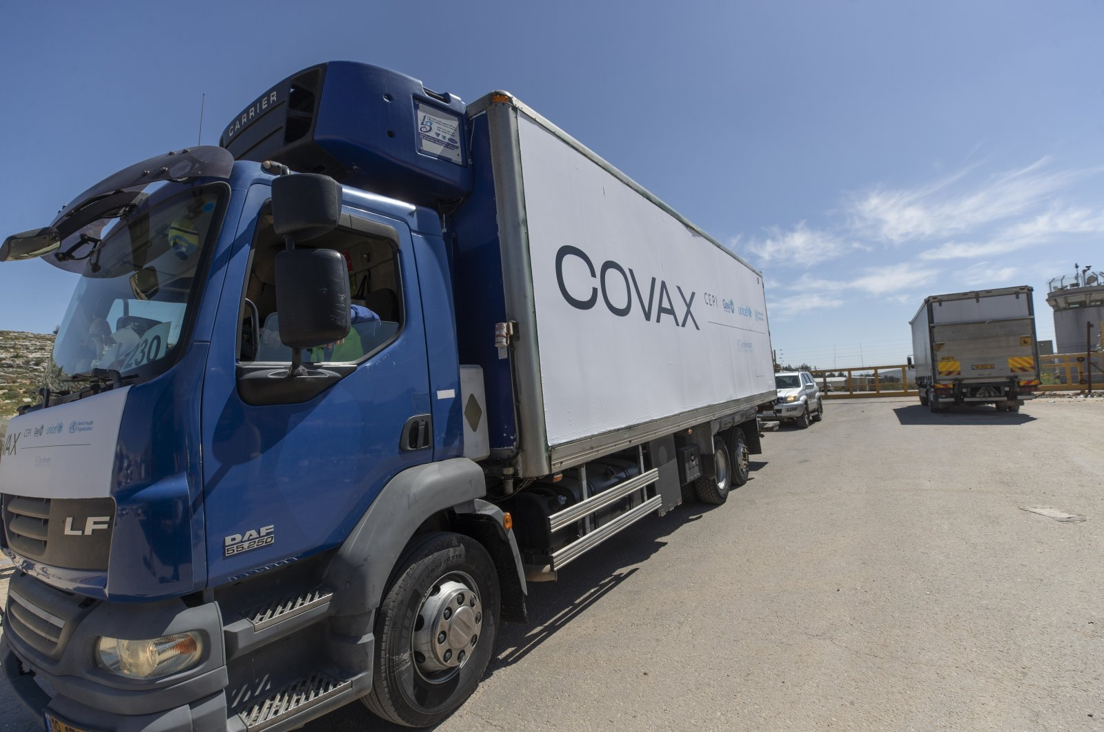 A U.N. convoy carrying coronavirus vaccines passes through the Israeli Ofer crossing heading to a Palestinian health ministry's warehouse, on the outskirts of the West Bank city of Ramallah, March 17, 2021. (AP Photo)