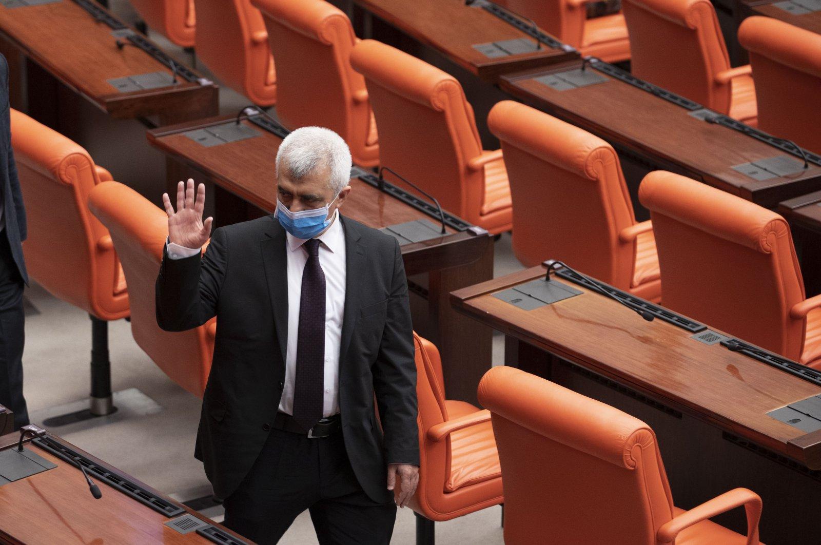 Then-HDP deputy  Ömer Faruk Gergerlioğlu waves after a session in the Turkish Parliament, Ankara, Turkey, March 17, 2021. (AA)