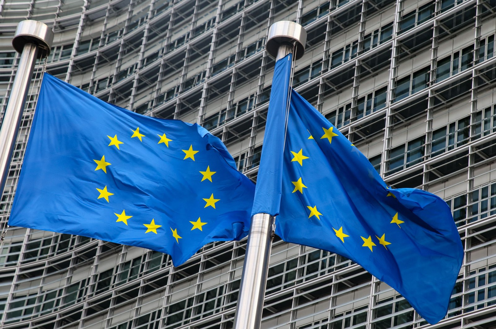European Union flags fly outside the headquarters of the European Commission in Brussels, Belgium, March 11, 2021. (AFP Photo)