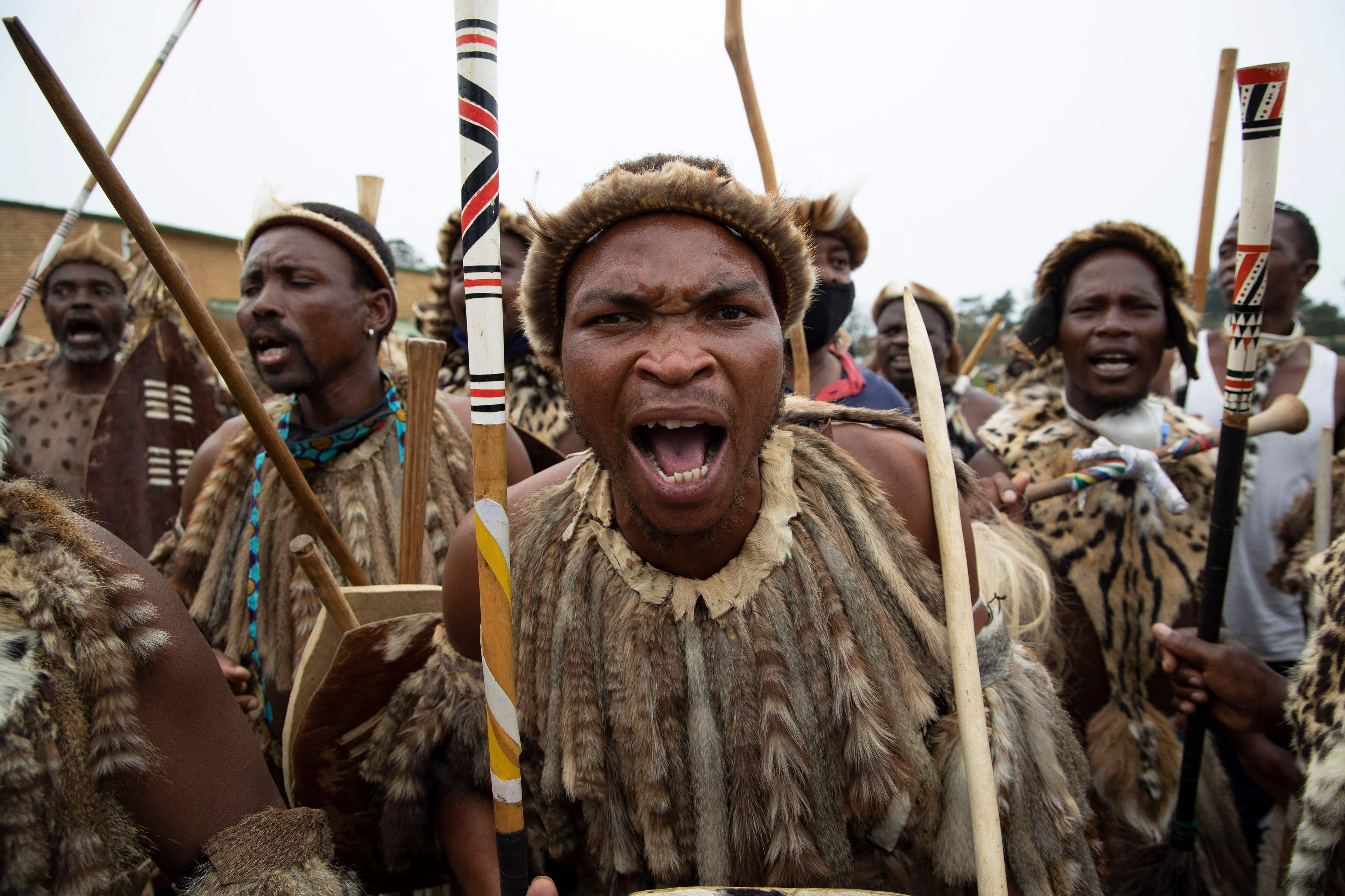 Zulu regiments, also known as amaButho, make their way to the mortuary to receive the body of King Goodwill Zwelithini from in Nongoma, KwaZulu Natal, South Africa, March 17, 2021. (AFP Photo)