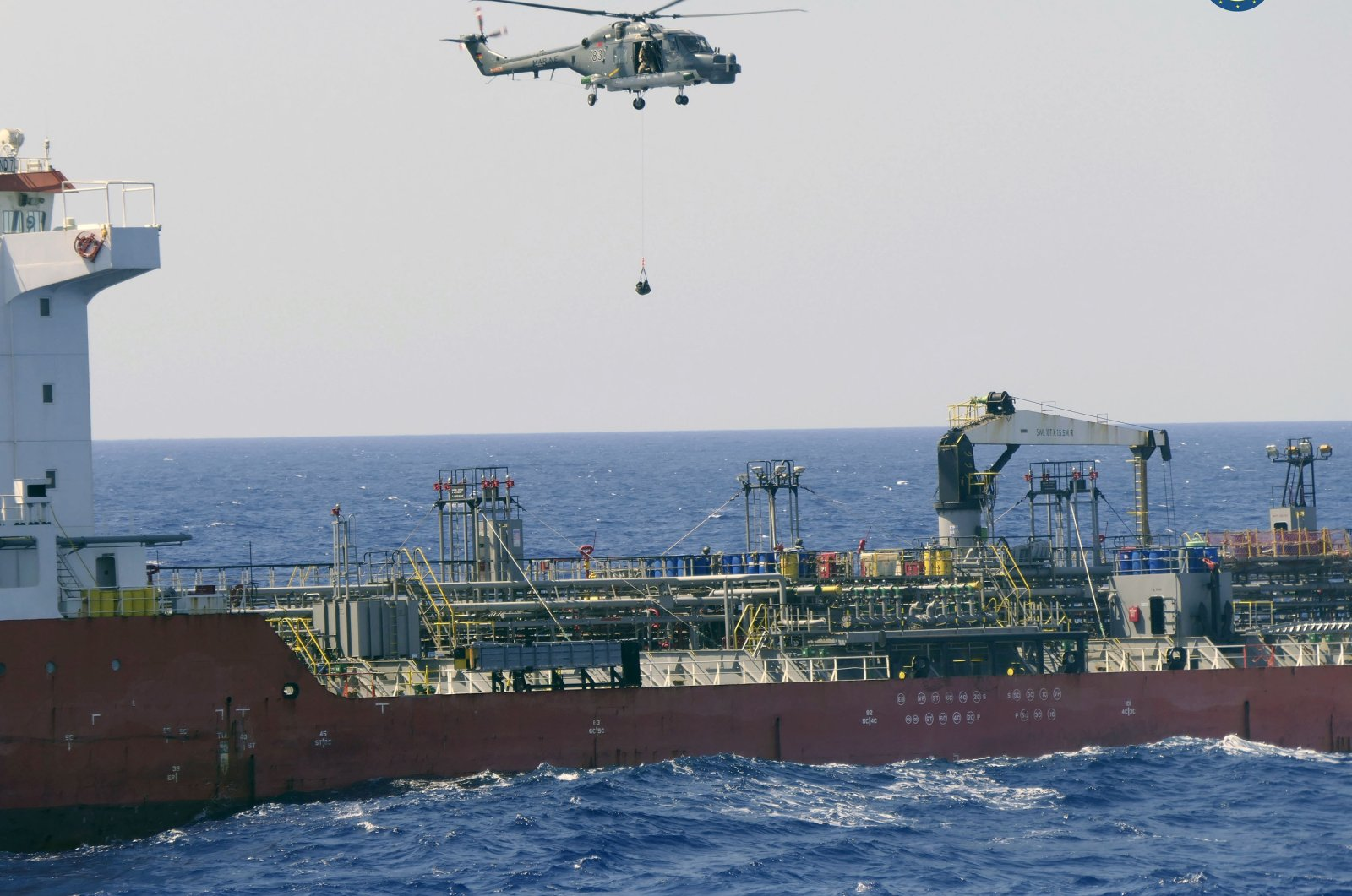 A boarding team boards the Merchant Vessel Royal Diamond 7, in international waters, 150 kilometers (93 miles) north of Derna, Libya, Sept. 10, 2020. (AP Photo)