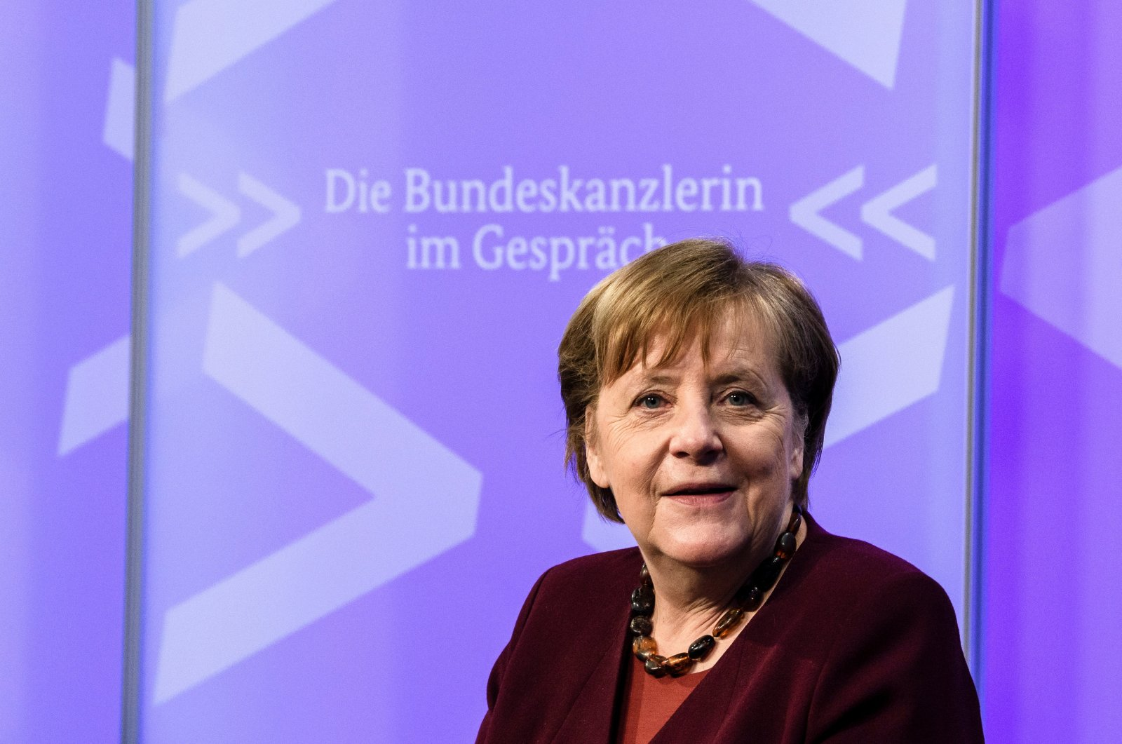 Germany's Chancellor Angela Merkel looks on prior to the beginning of a video conference as part of her citizens' dialogue series, in Berlin, Germany March 10, 2021. (Clemens Bilan / Pool via Reuters)