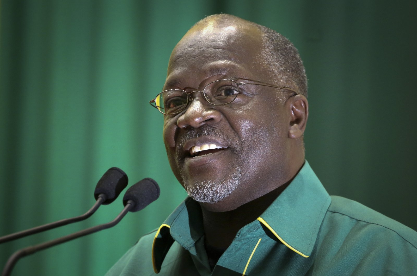 In this Saturday, July 11, 2015 file photo, Tanzania's then public works minister and presidential candidate John Magufuli speaks at an internal party poll to decide the ruling Chama Cha Mapinduzi (CCM) party's presidential candidate, which they later chose him to be, in Dodoma, Tanzania. (AP Photo)
