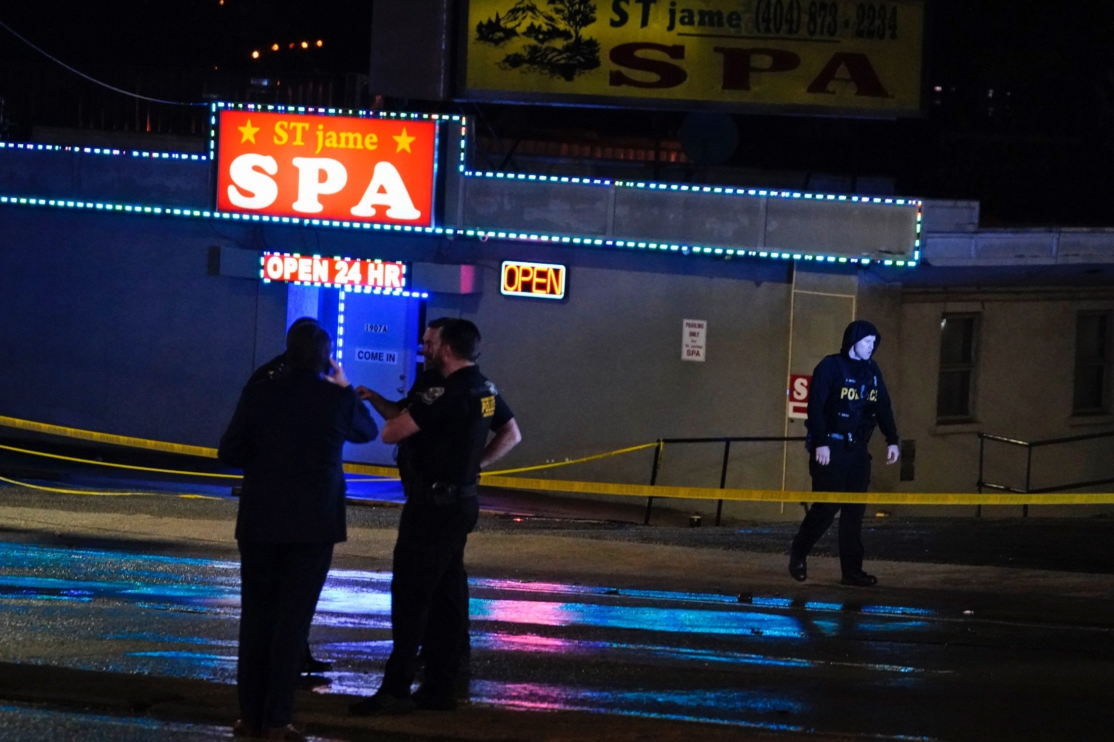 Officials stand in front of a massage parlor after a shooting, Atlanta, Georgia, U.S., March 16, 2021. (AP Photo)