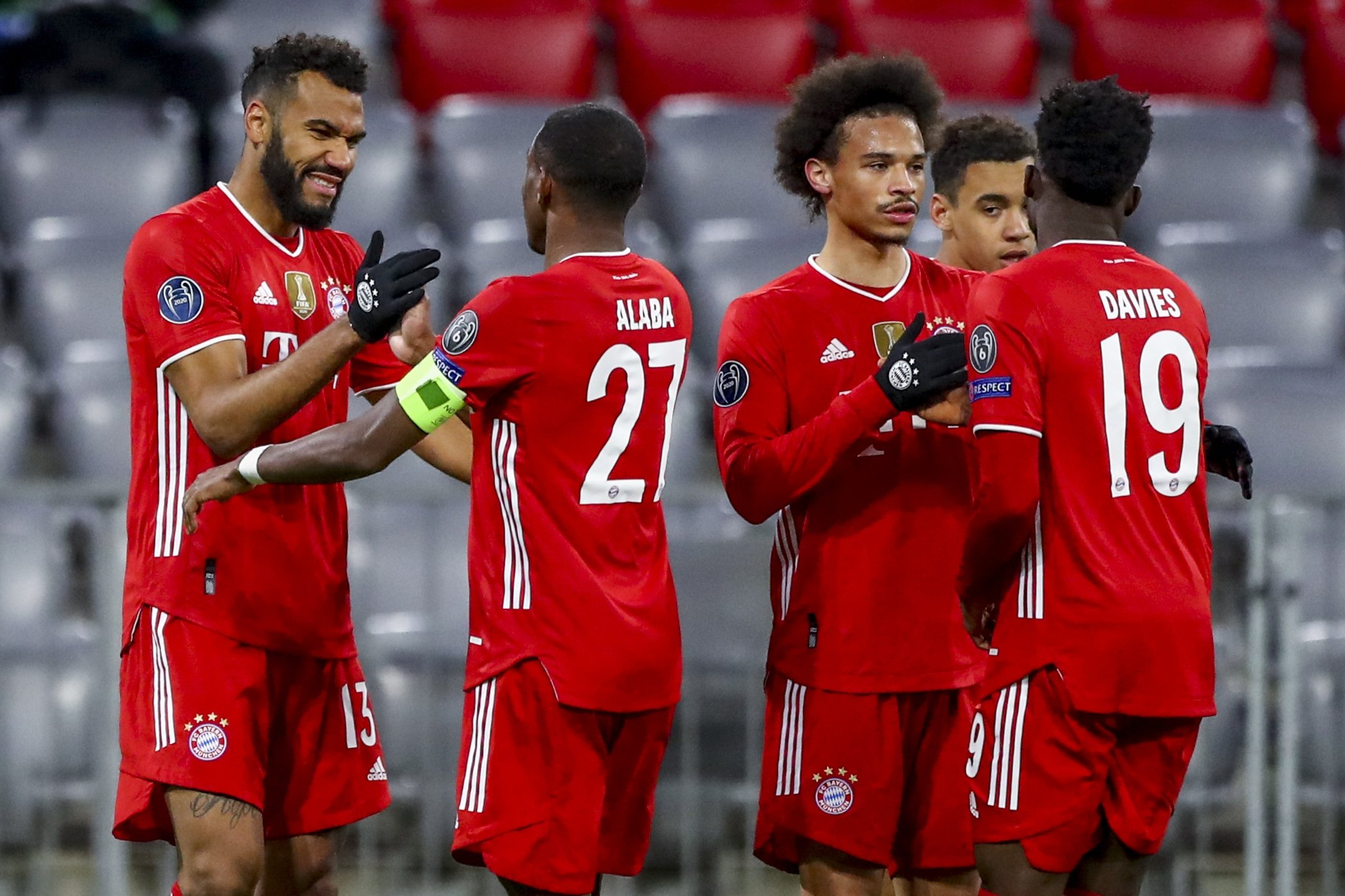 Bayern's Eric Maxim Choupo-Moting (L) celebrates a goal with his teammates during the Champions League, round of 16, second leg match in Munich, Germany, March 17, 2021. (AP Photo)