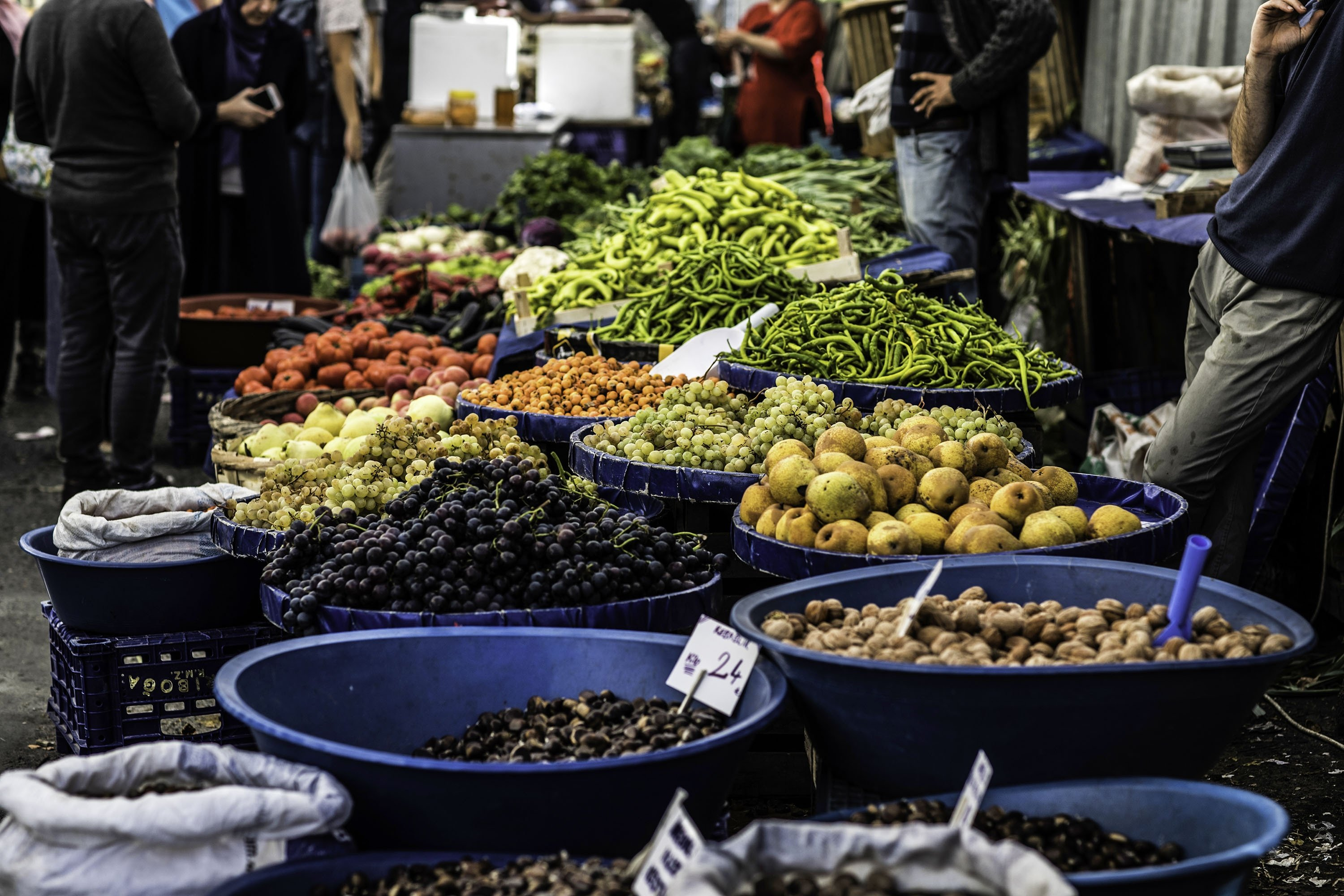 A vendor sells vegetables in the organic market in Kasımpaşa, Istanbul on October 13, 2019. (Getty Images)