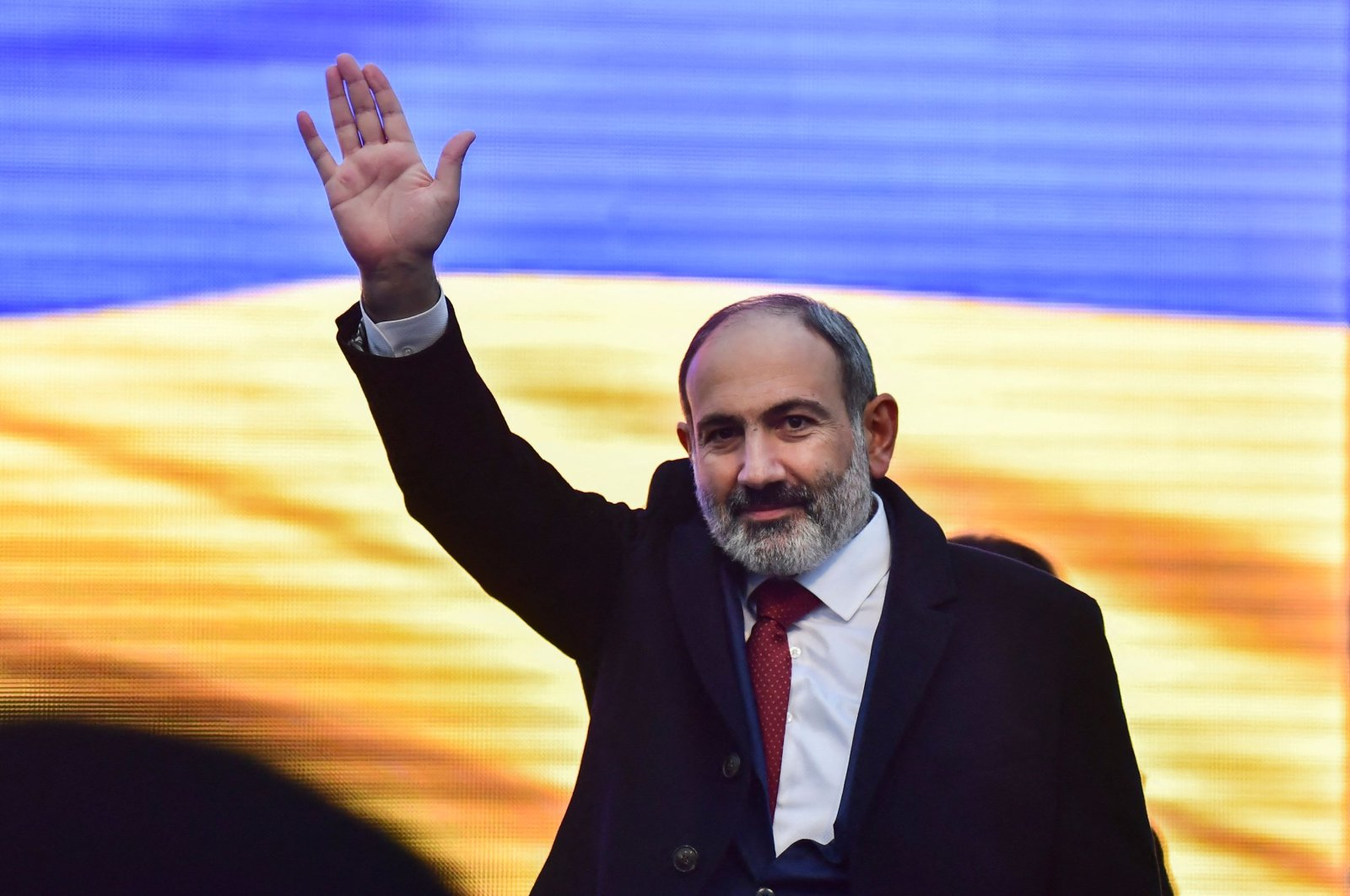 Armenian Prime Minister Nikol Pashinian greets his supporters gathered at Republic Square in downtown Yerevan, Armenia, March 1, 2021. (AFP Photo)