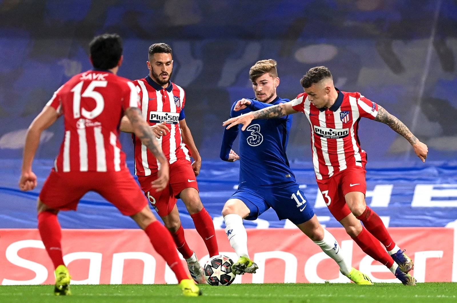 Chelsea's Timo Werner (2nd R) in action against Atletico players Koke (2nd L) and Kieran Trippier (R) during the UEFA Champions League Round of 16, second leg match in London, Britain, 17 March 2021. (EPA Photo)