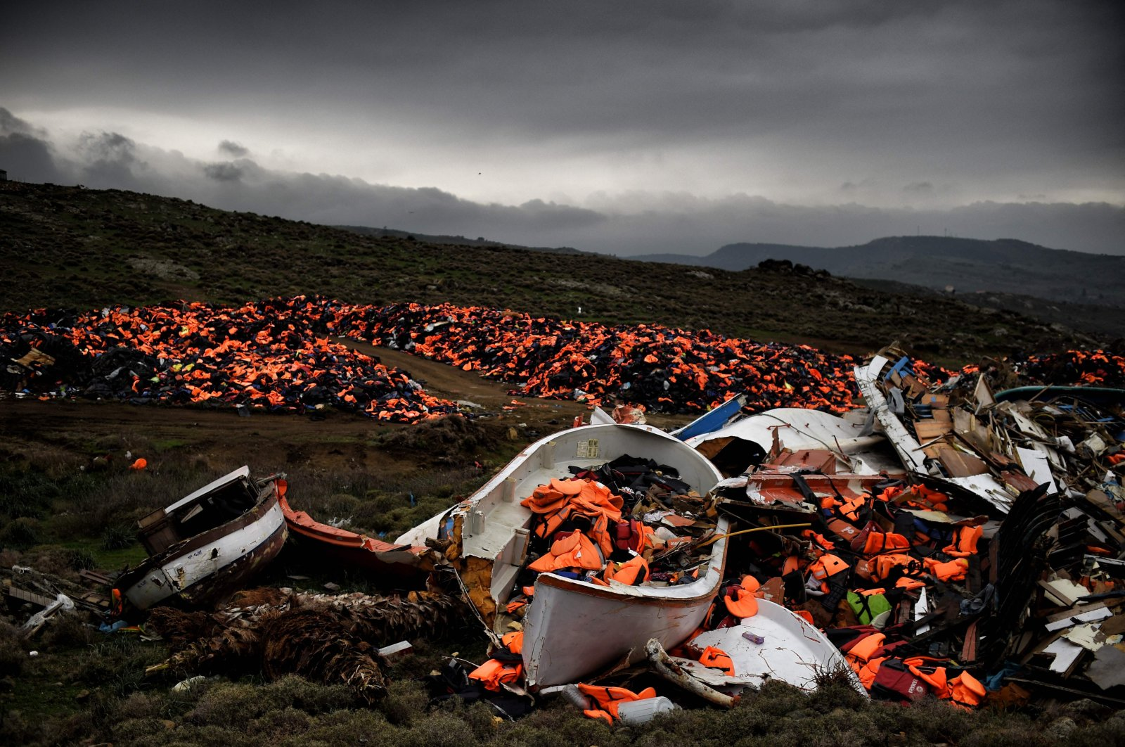 Wrecked boats and thousands of life jackets used by refugees and migrants during their journey across the Aegean sea lie in a dump in Mithimna, Greece, Feb. 19, 2016. (AFP)