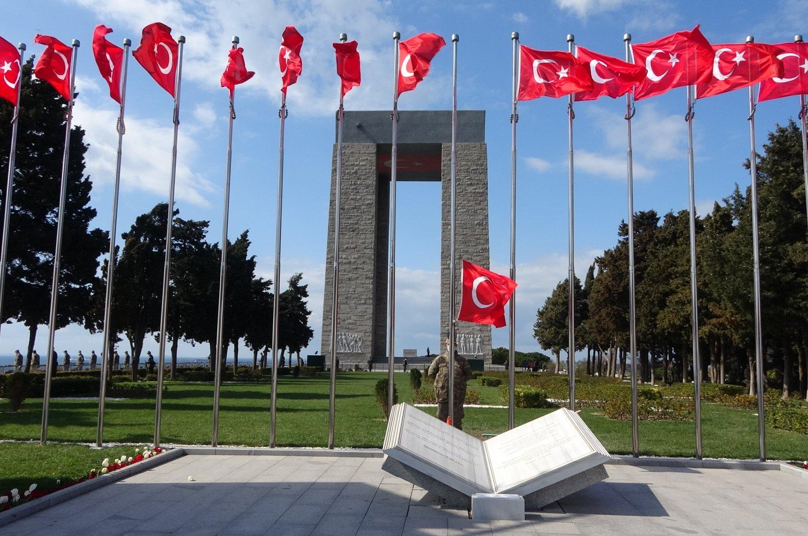 Martyr's Memorial is seen behind Turkish flags, Çanakkale, northwestern Turkey, March 18, 2021. (İHA Photo)
