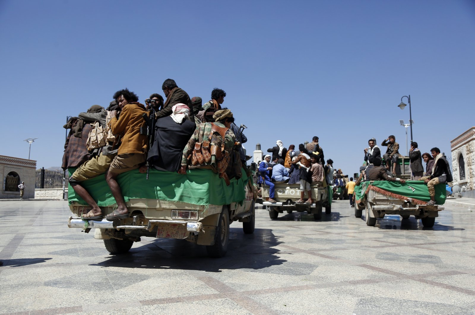 Houthi followers ride vehicles after having participated in a funeral for their fighters killed in a clash between the Houthis and government forces over the Marib region, Sanaa, Yemen, March 9, 2021. (Photo by Getty Images)