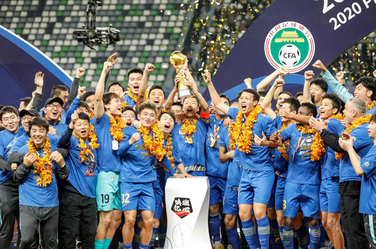 Jiangsu Suning players and staff members celebrate winning the Chinese Super League (CSL) title in Suzhou, eastern China, Nov. 12, 2020.(AFP Photo)